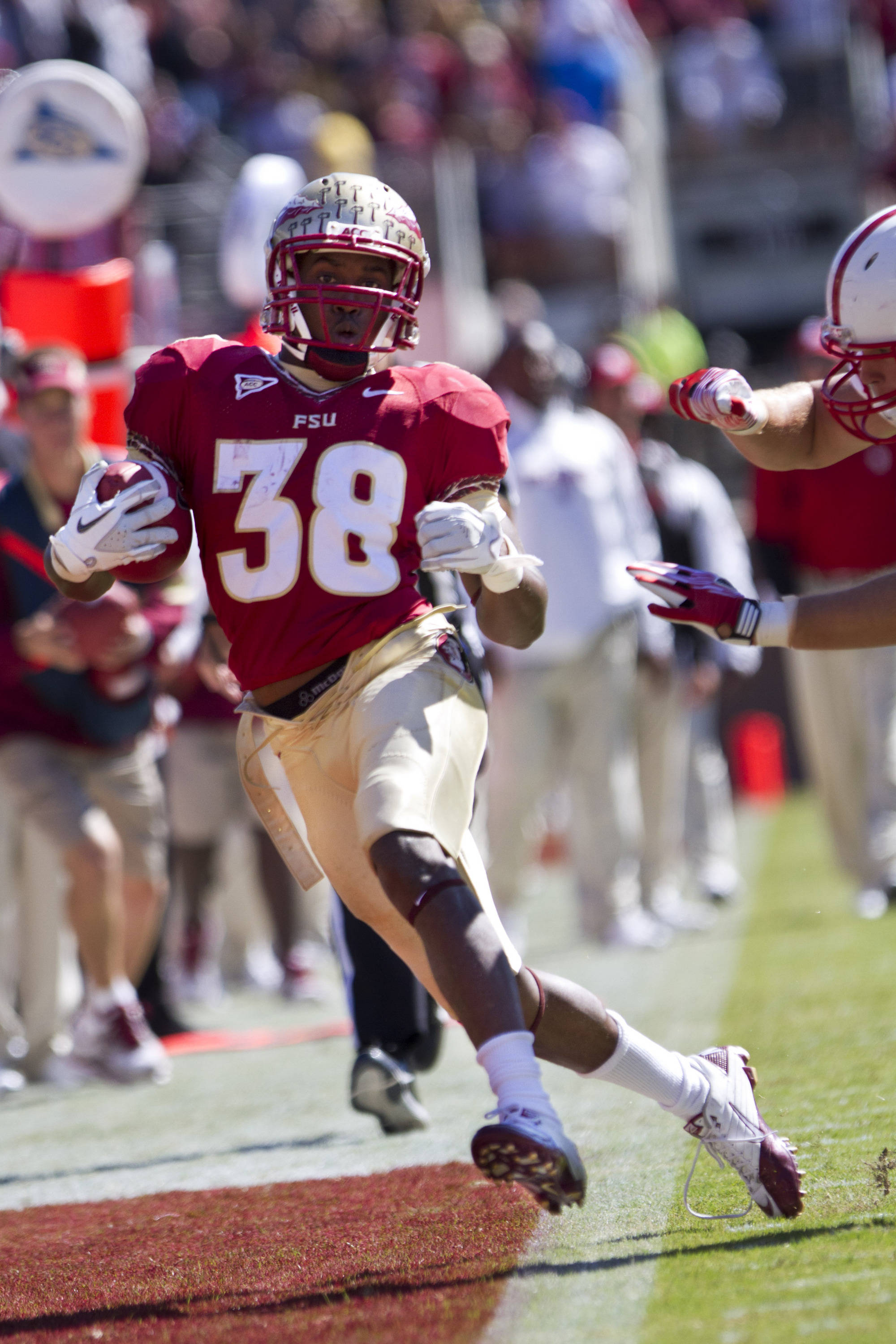 Jermaine Thomas (38) tries to stay in bounds as he runs down the sideline during the football game against NC State on October 29, 2011.