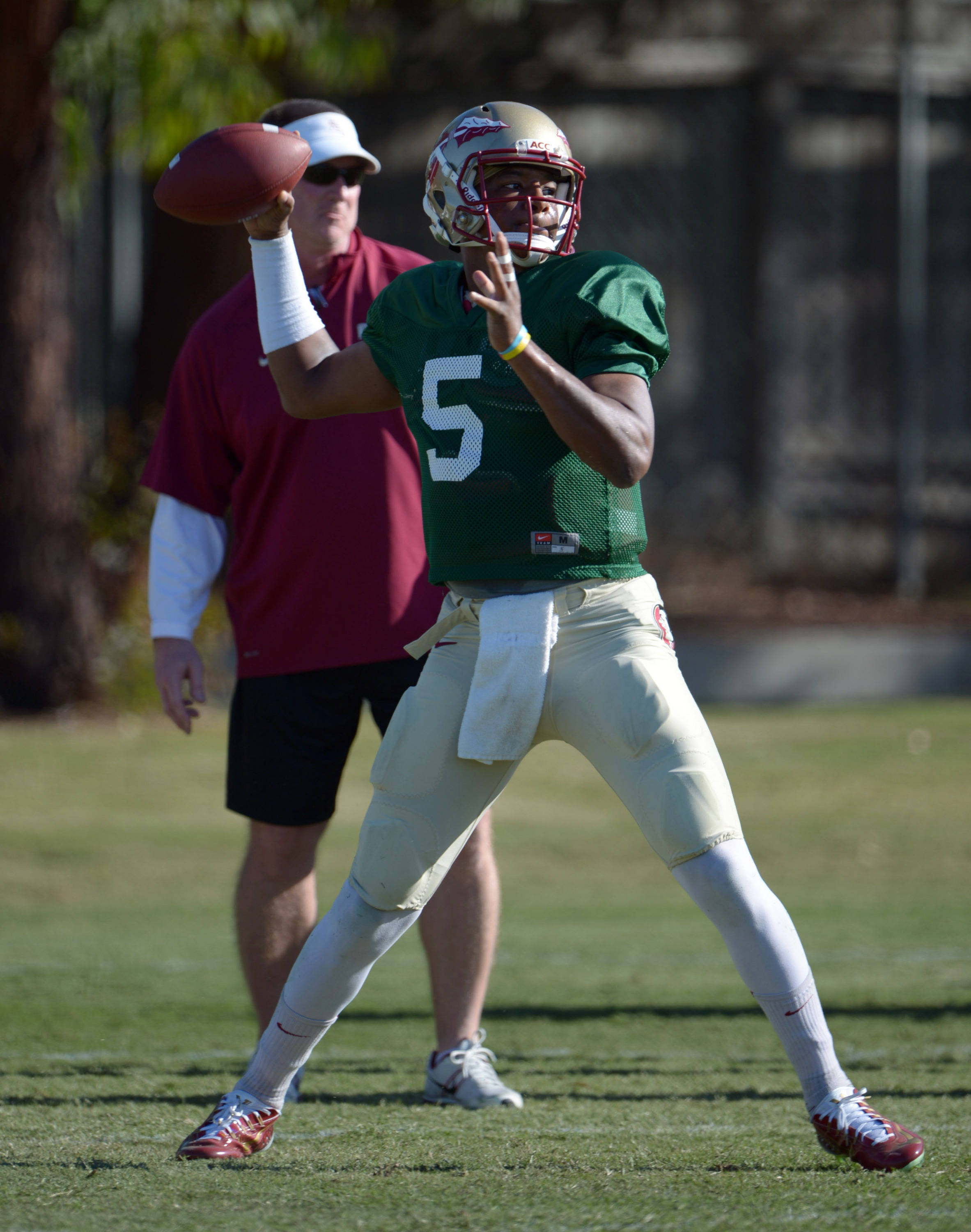 Florida State Seminoles quarterback Jameis Winston (5) throws a pass under the supervision of quarterbacks coach Randy Sanders at practice for the 2014 BCS National Championship. Mandatory Credit: Kirby Lee-USA TODAY Sports