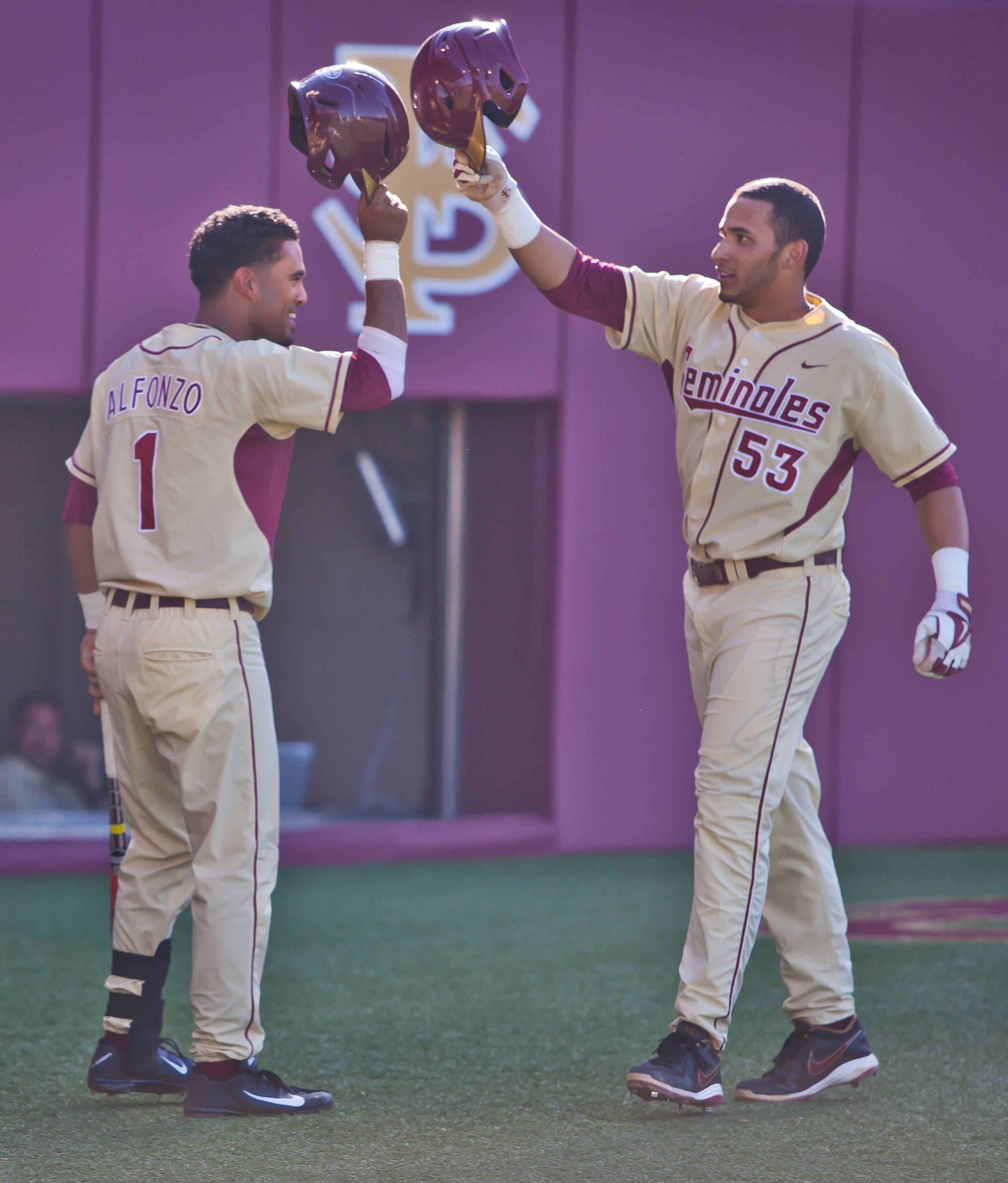 Giovanny Alfonzo greets Jose Brizuela after his third inning home run.