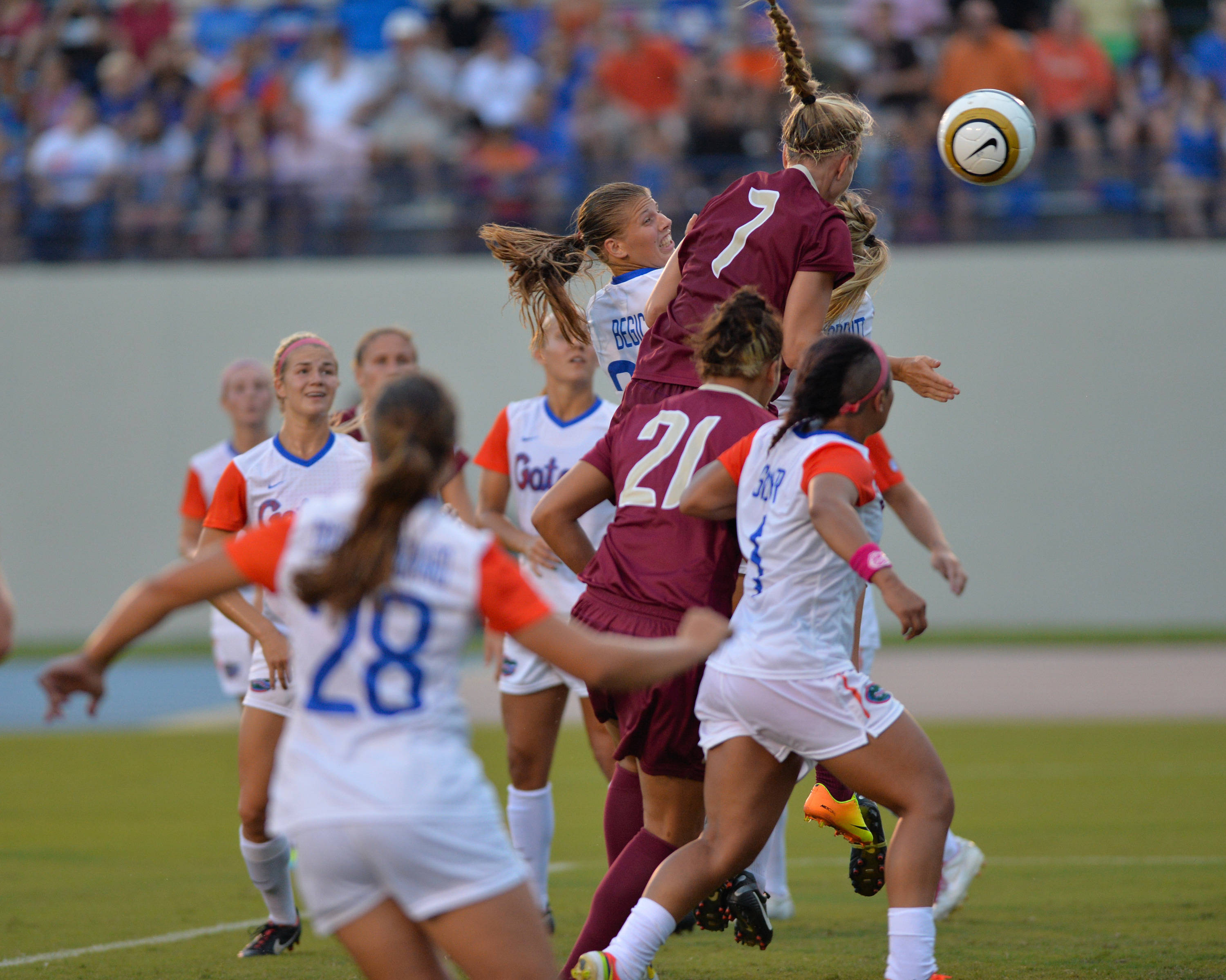 Dagny Brynjarsdottir soars through the air to head in her second goal of the evening.