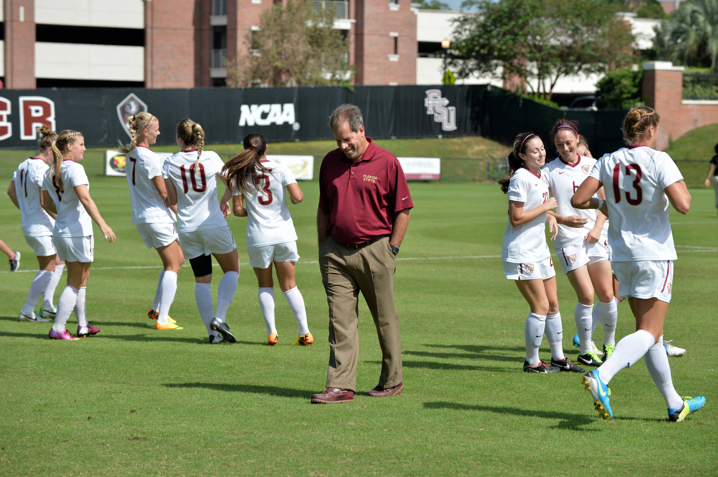 Head coach Mark Krikorian and the Seminoles during pregame on Sunday against Maryland.