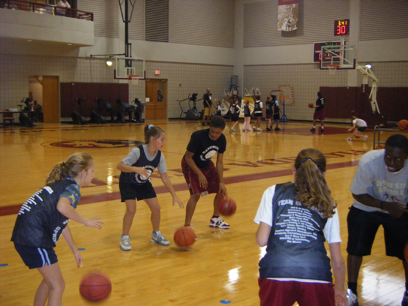 Freshman Courtney Ward instructing the girls on how to dribble.