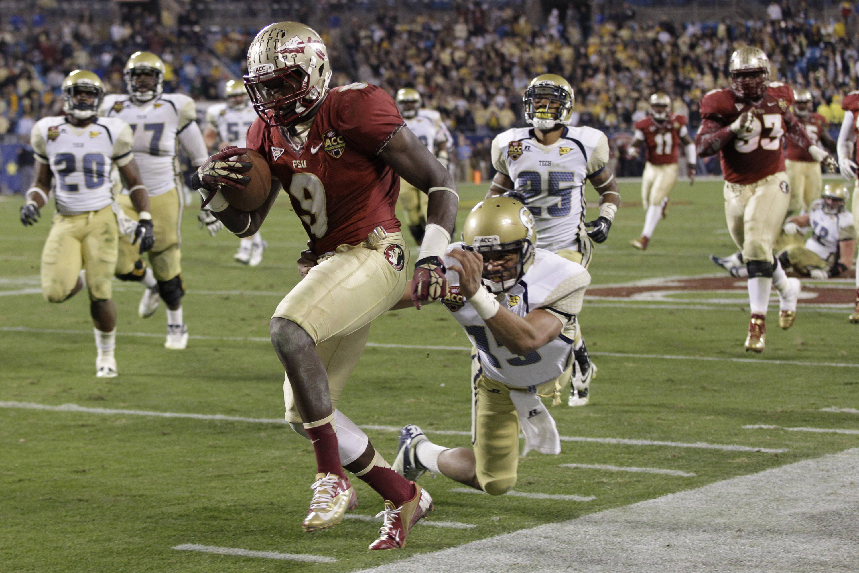 Florida State's Karlos Williams (9) returns an interception as Georgia Tech quarterback Tevin Washington (13) chases in vain during the second half. (AP Photo/Chuck Burton)
