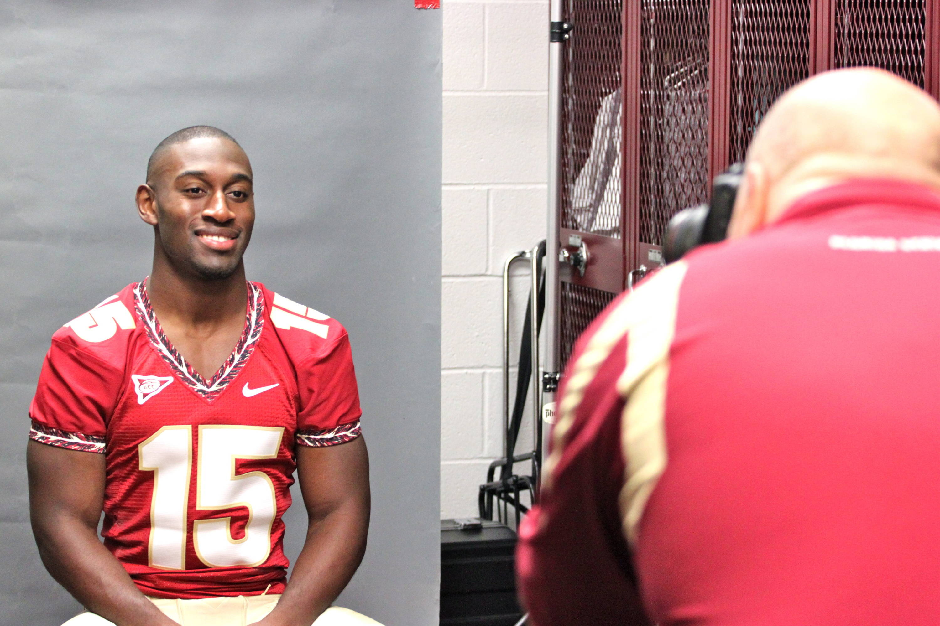 Ochuko Jenije (15) taking his picture during media day.