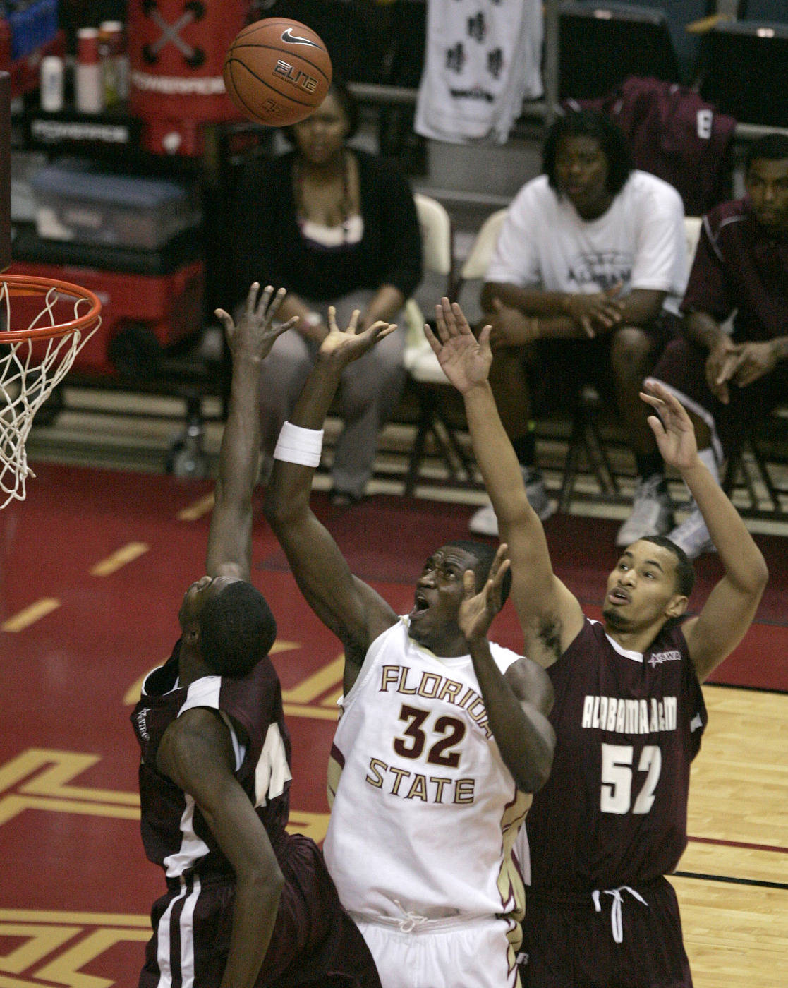 Florida State's Solomon Alabi get a shot off between the defense of Alabama A&M's Bo Amusa, left and Adam Young in the first half of an NCAA college basketball game on Thursday, Dec. 31, 2009, in Tallahassee, Fla. (AP Photo/Steve Cannon)
