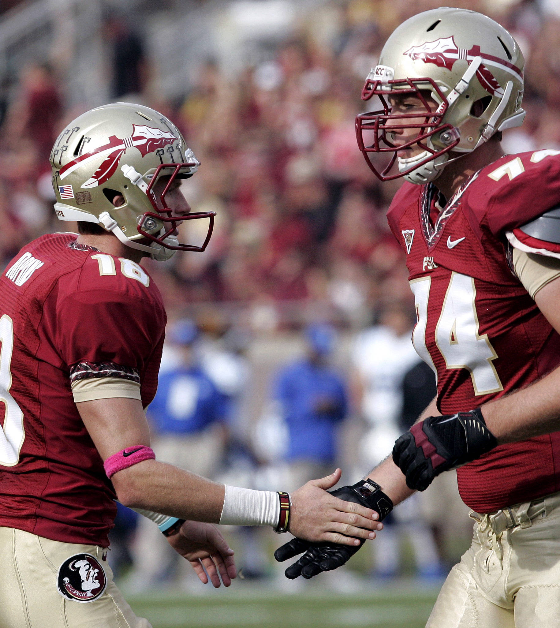 Florida State's Dustin Hopkins, left, is congratulated by teammate Jonathan Wallace after kicking a field goal against Duke in the first quarter. (AP Photo/Steve Cannon)
