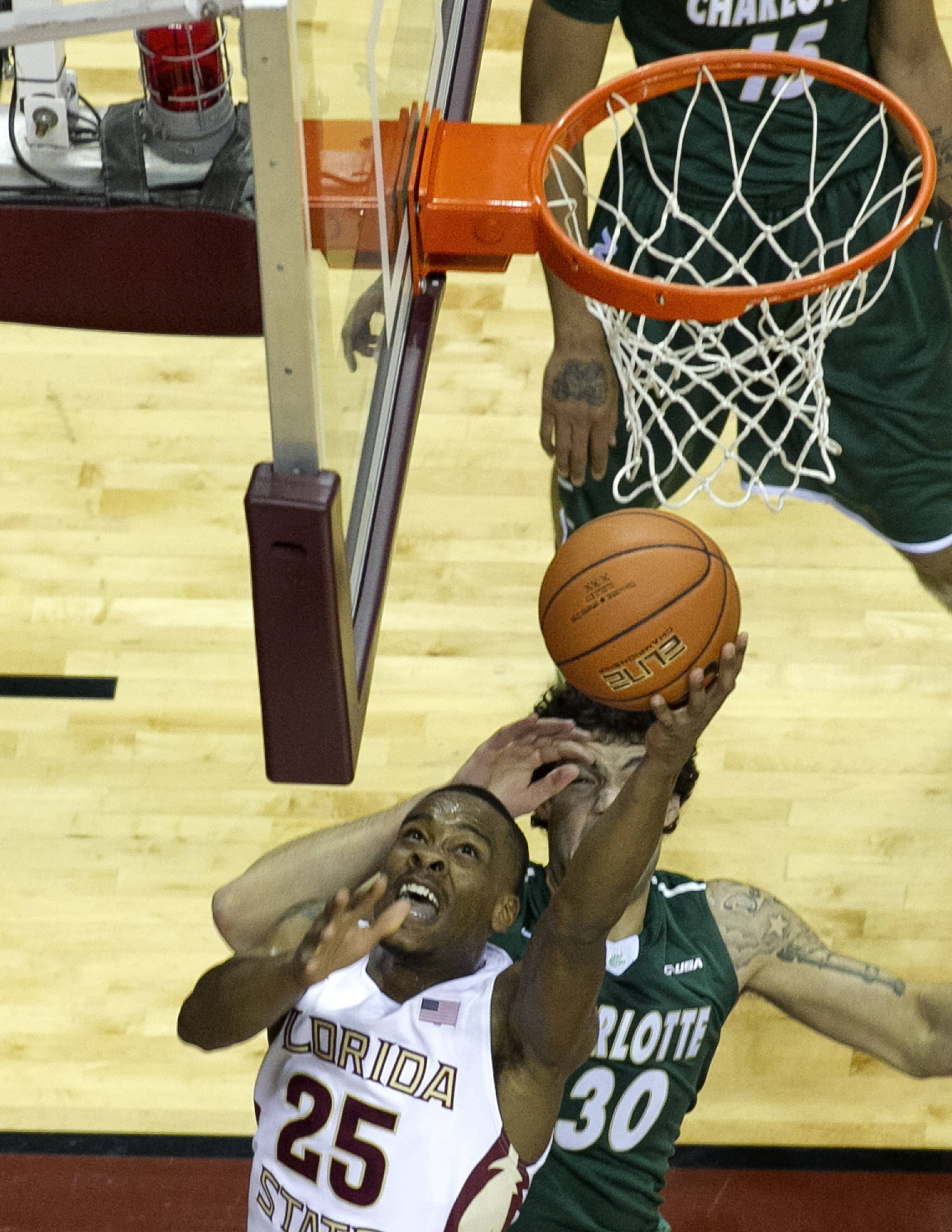 Aaron Thomas (25) with a reverse lay-up, FSU vs Charlotte, 12-17-13,  (Photo by Steve Musco)