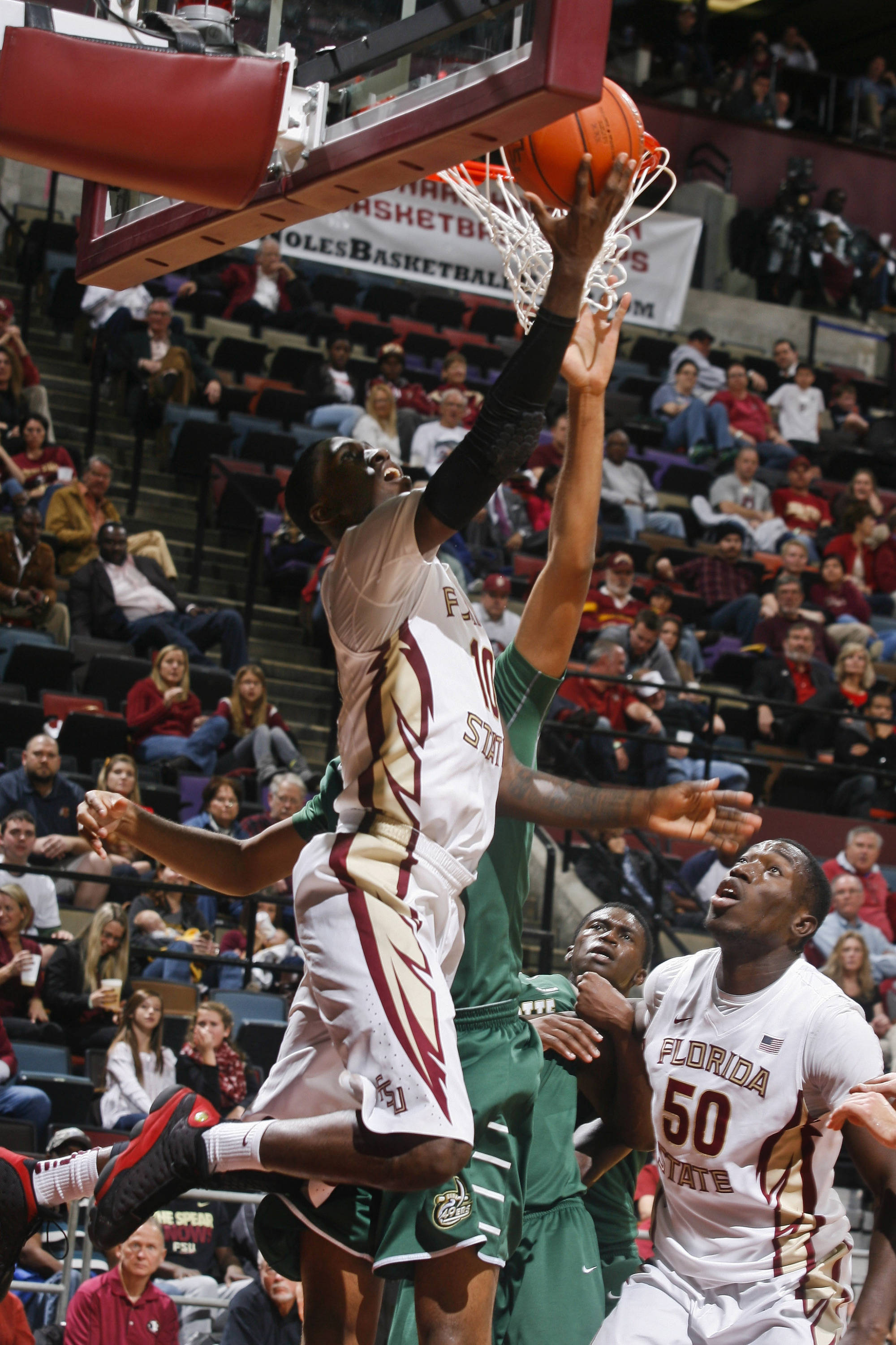 Dec 17, 2013; Tallahassee, FL, USA; Florida State Seminoles forward Okaro White (10) makes a reverse layup as he is fouled in the second half of their game against the Charlotte 49ers at the Donald L. Tucker Center. The Florida State Seminoles beat the Charlotte 49ers 106-62. Mandatory Credit: Phil Sears-USA TODAY Sports