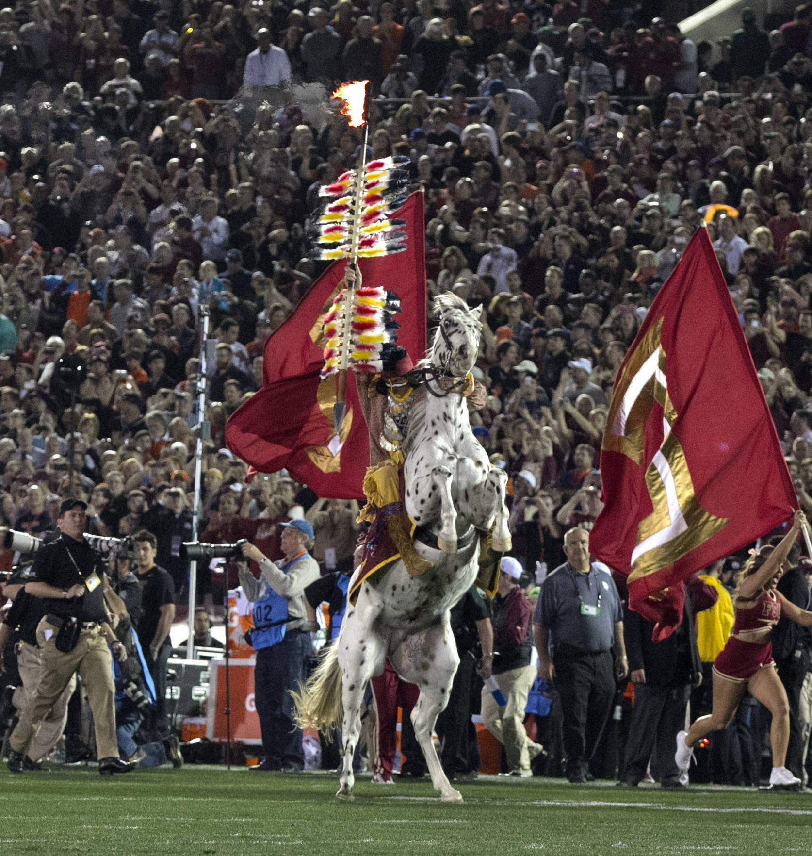 National Television gets to enjoy Chief Osceola planting the spear, BCS Championship, FSU vs Auburn, Rose Bowl, Pasadena, CA,  1-06-14,  (Photo by Steve Musco)