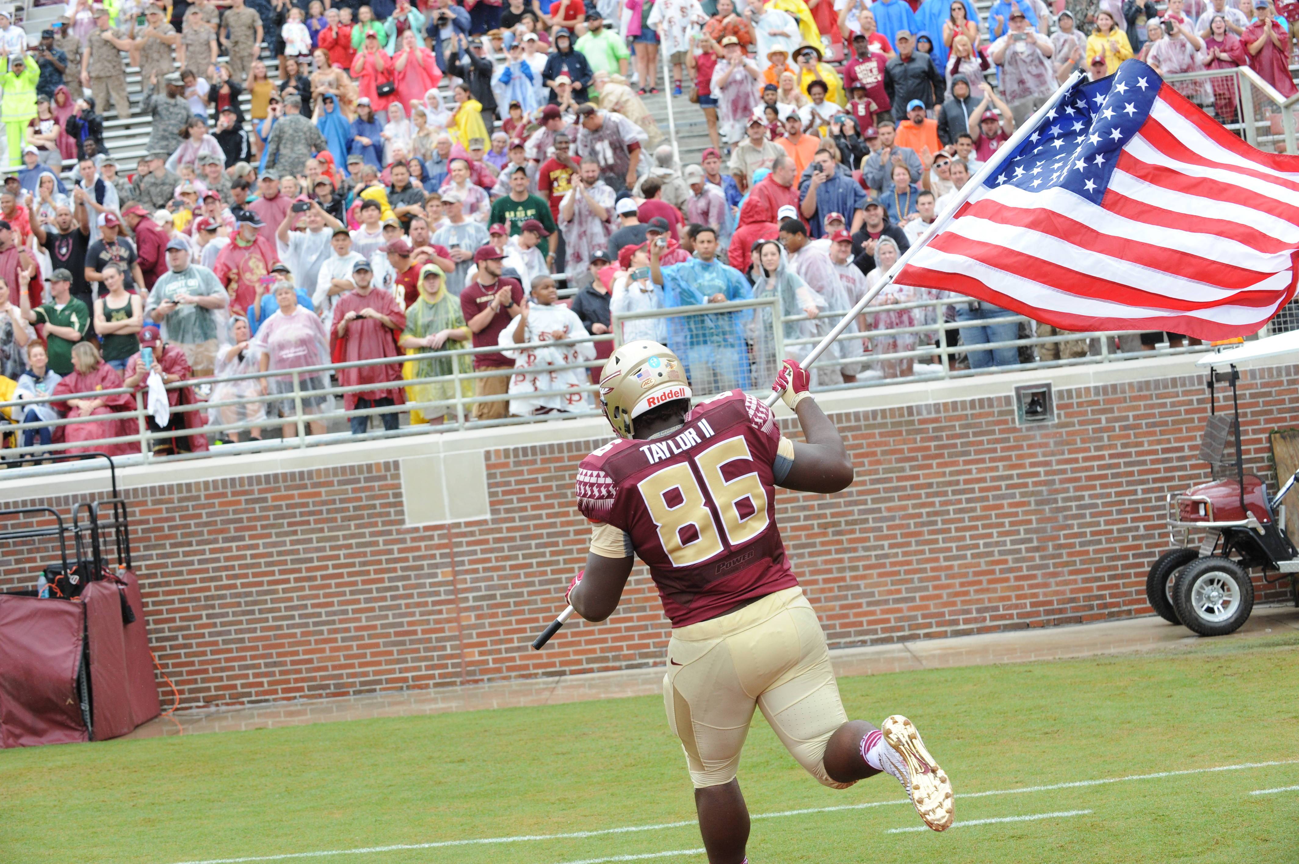 Darvin Taylor reaches the south endzone with the American Flag - Mitch White