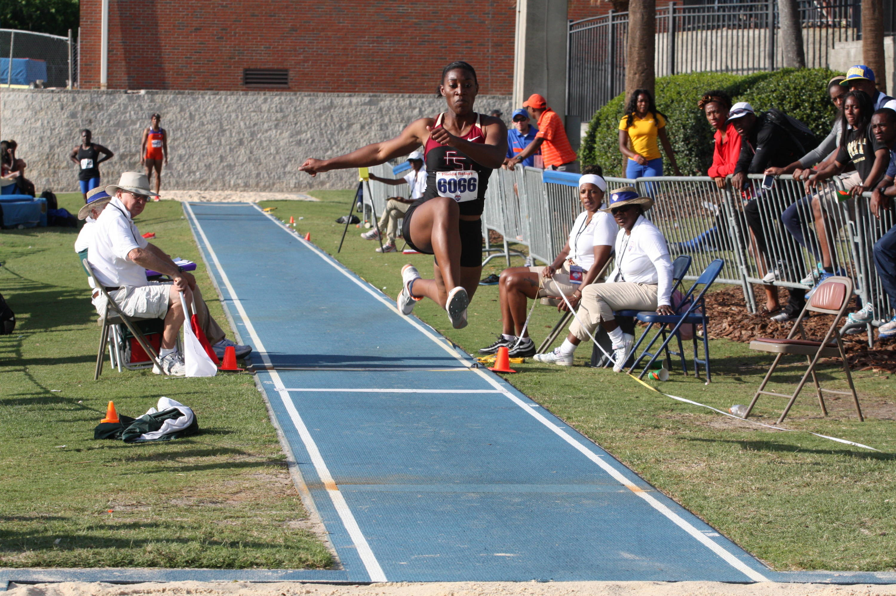 Michelle Jenije takes off en route to her Florida Relays triple jump victory.