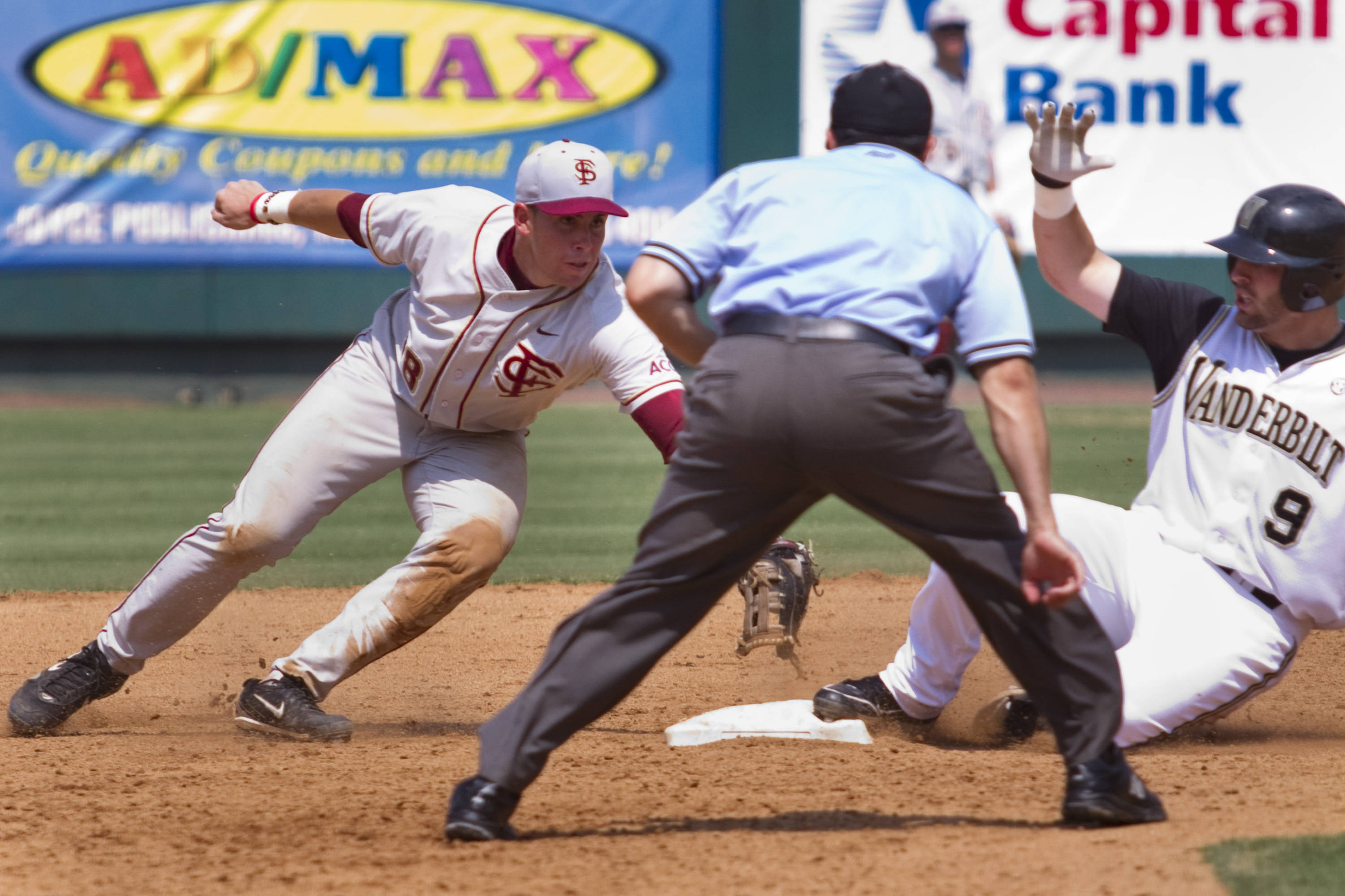 Stephen Cardullo (38) lunges to tag out Vanderbilt's Curt Casali (9) at second in the bottom of the eighth inning.