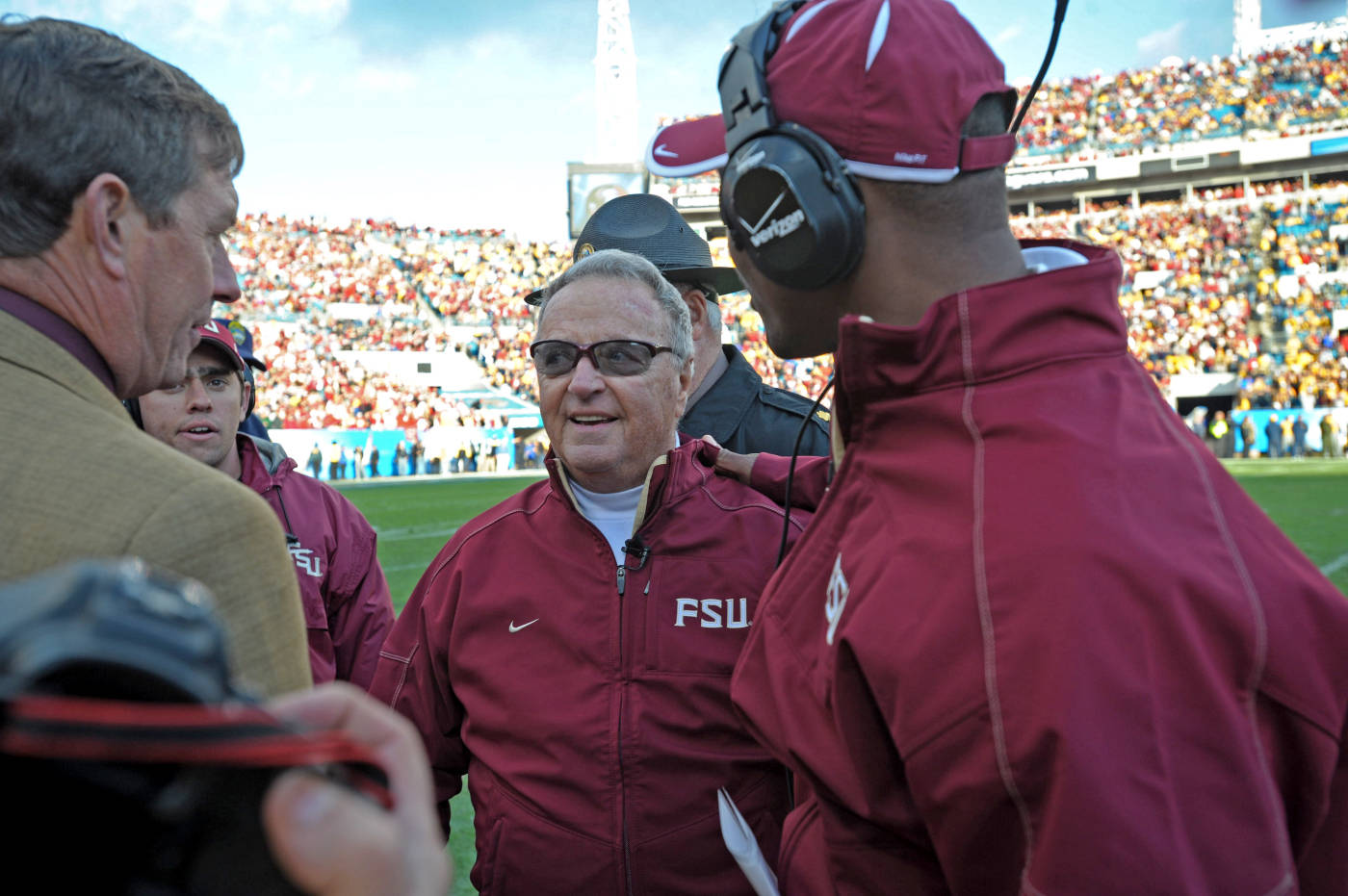 Athletics Director Randy Spetman greets Coach Bowden on the sideline