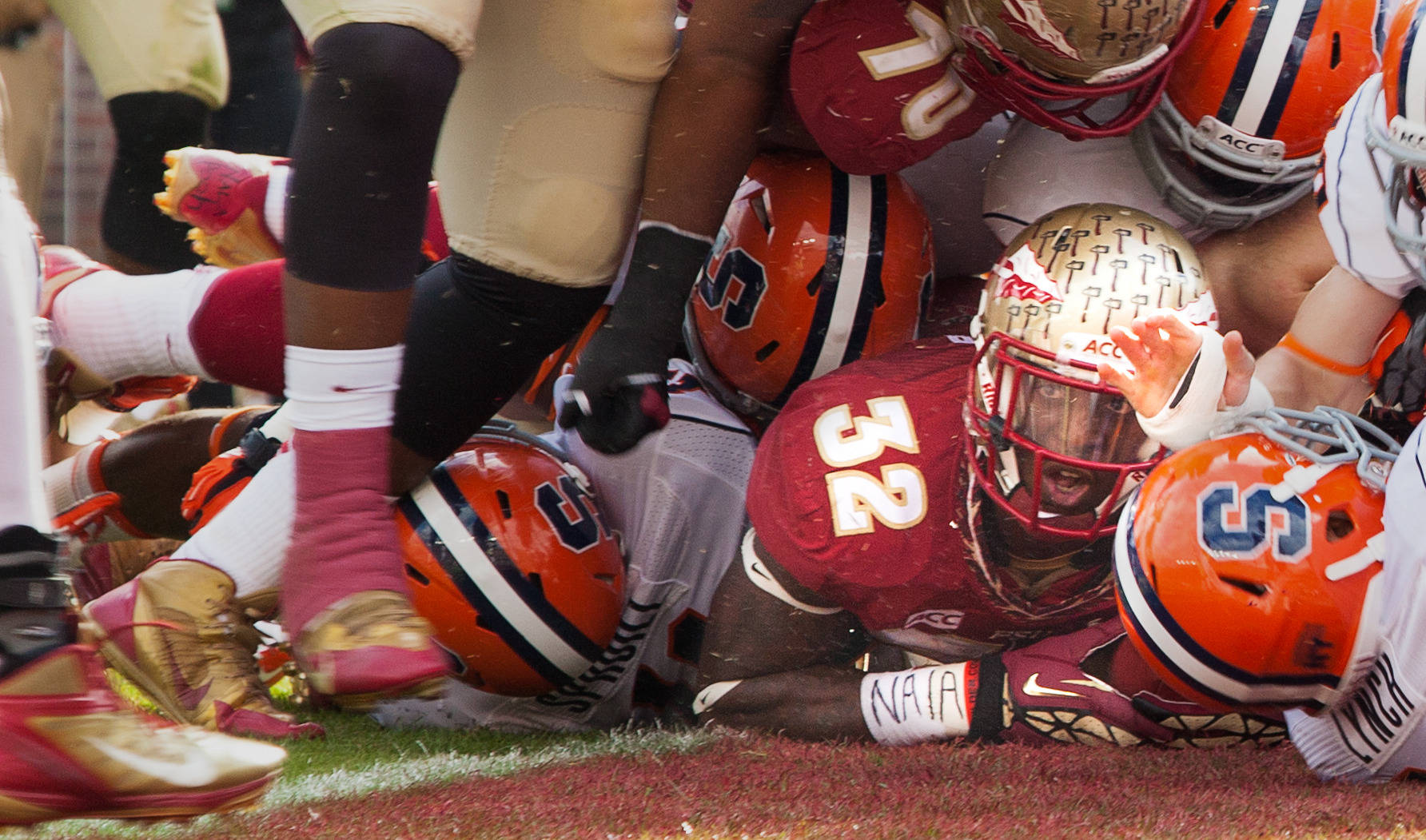 James Wilder, Jr. (32) looks up after scoring a touchdown during FSU Football's 59-3 win over Syracuse on Saturday, November 16, 2013 in Tallahassee, Fla. Photo by Mike Schwarz.