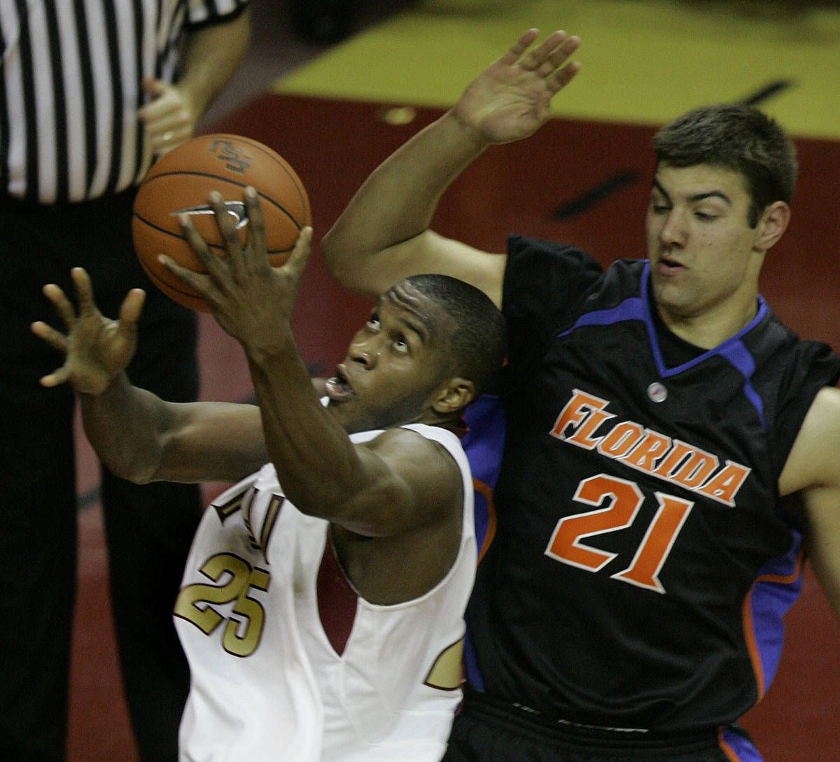 Florida State's Jason Rich, left, shoots for two first-half points as Florida's Dan Werner attempts to defend during a college basketball game, Sunday, Dec. 3, 2006, in Tallahassee, Fla.(AP Photo/Phil Coale)