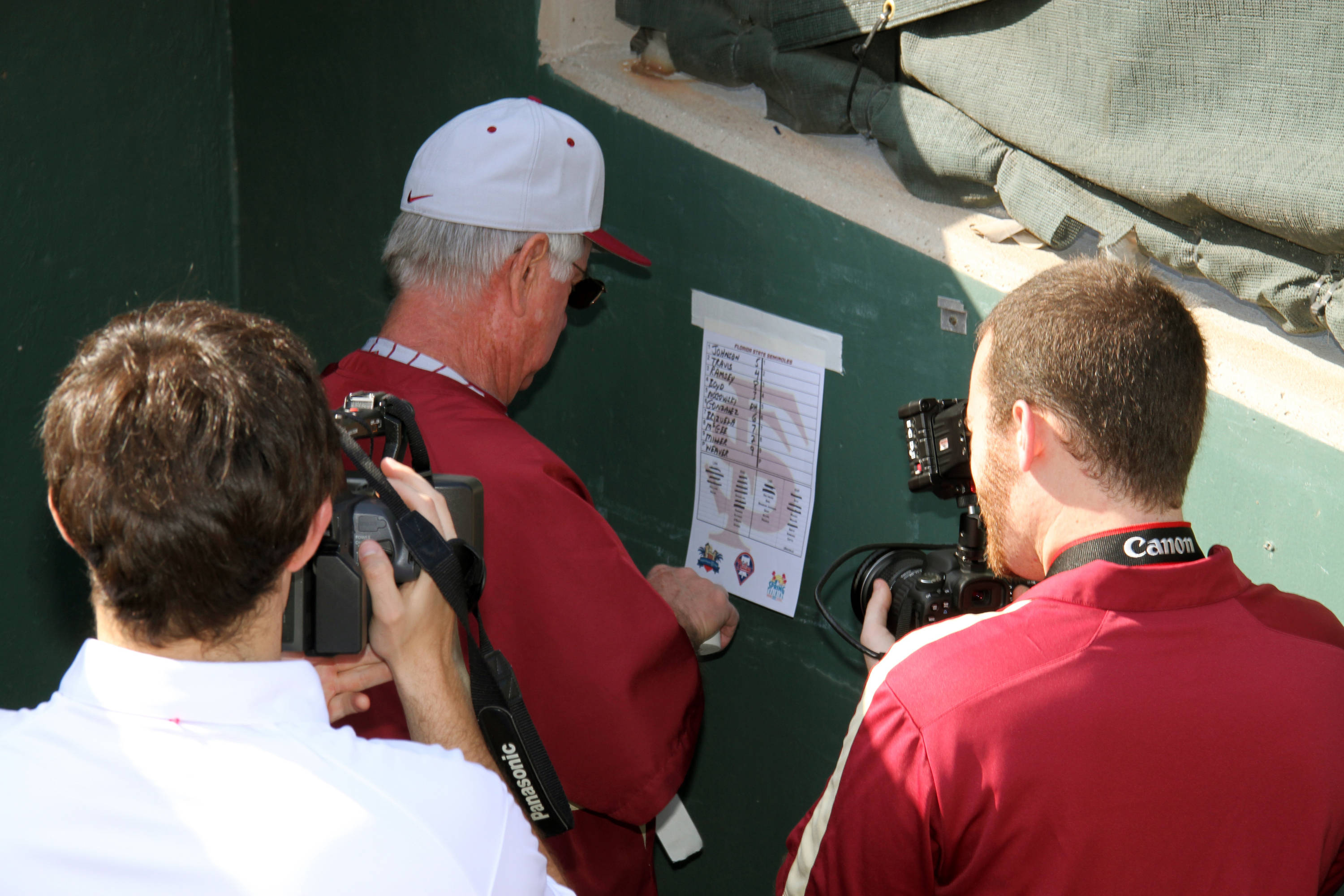 Head coach Mike Martin fills out the line up card.