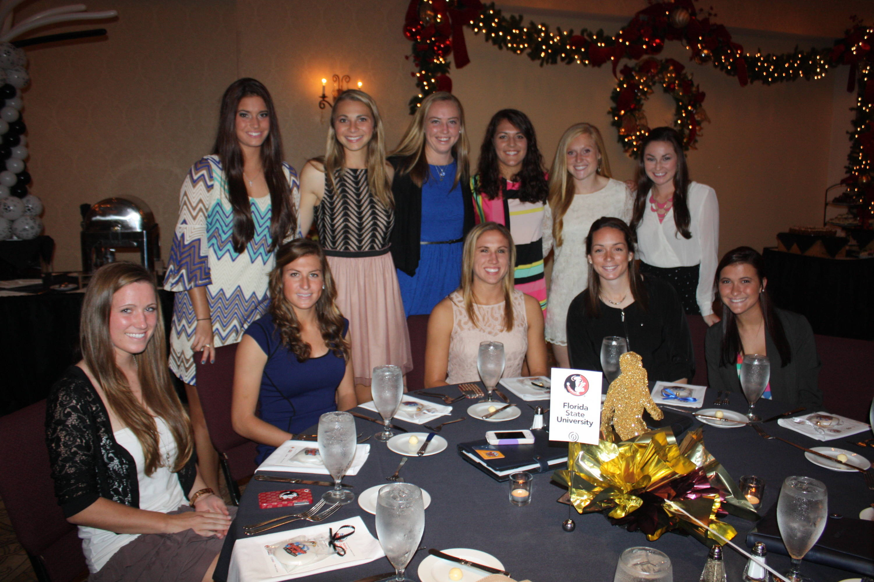 Florida State at the 2013 College Cup Banquet. Back Row (L to R): Ani Sarkisian, Anna McClung, Cassie Miller, Marta Bakowska-Mathews, Kacy Scarpa, Kirsten Crowley; Isabella Schmid, Kassey Kallman, Kristin Grubka, Kelsey Wys and Carson Pickett.