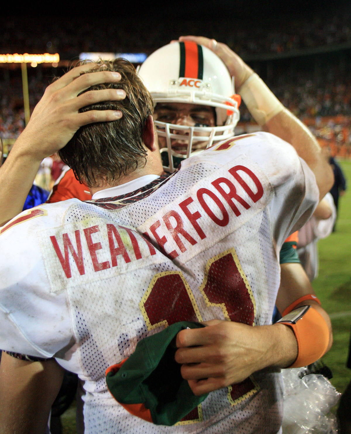 Miami backup quarterback Kirby Freeman, rear, congratulates Florida State quarterback Drew Weatherford after Florida State defeated Miami 13-10 Monday, Sept. 4, 2006 at the Orange Bowl in Miami. (AP Photo/Luis M. Alvarez)