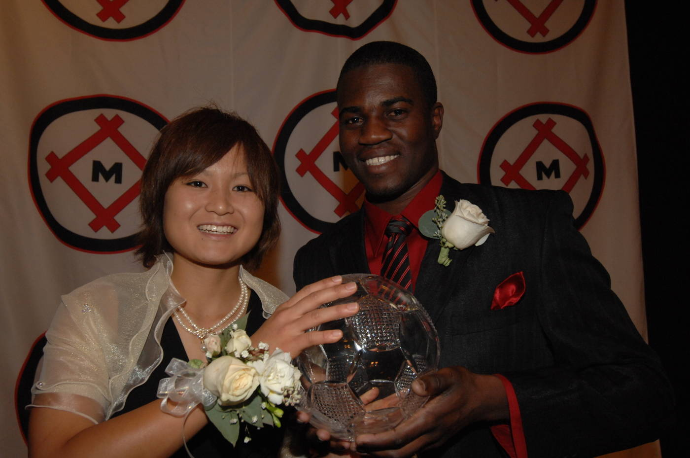 2007 Hermann Trophy winners Mami Yamaguchi and Connecticut's O'Brian White