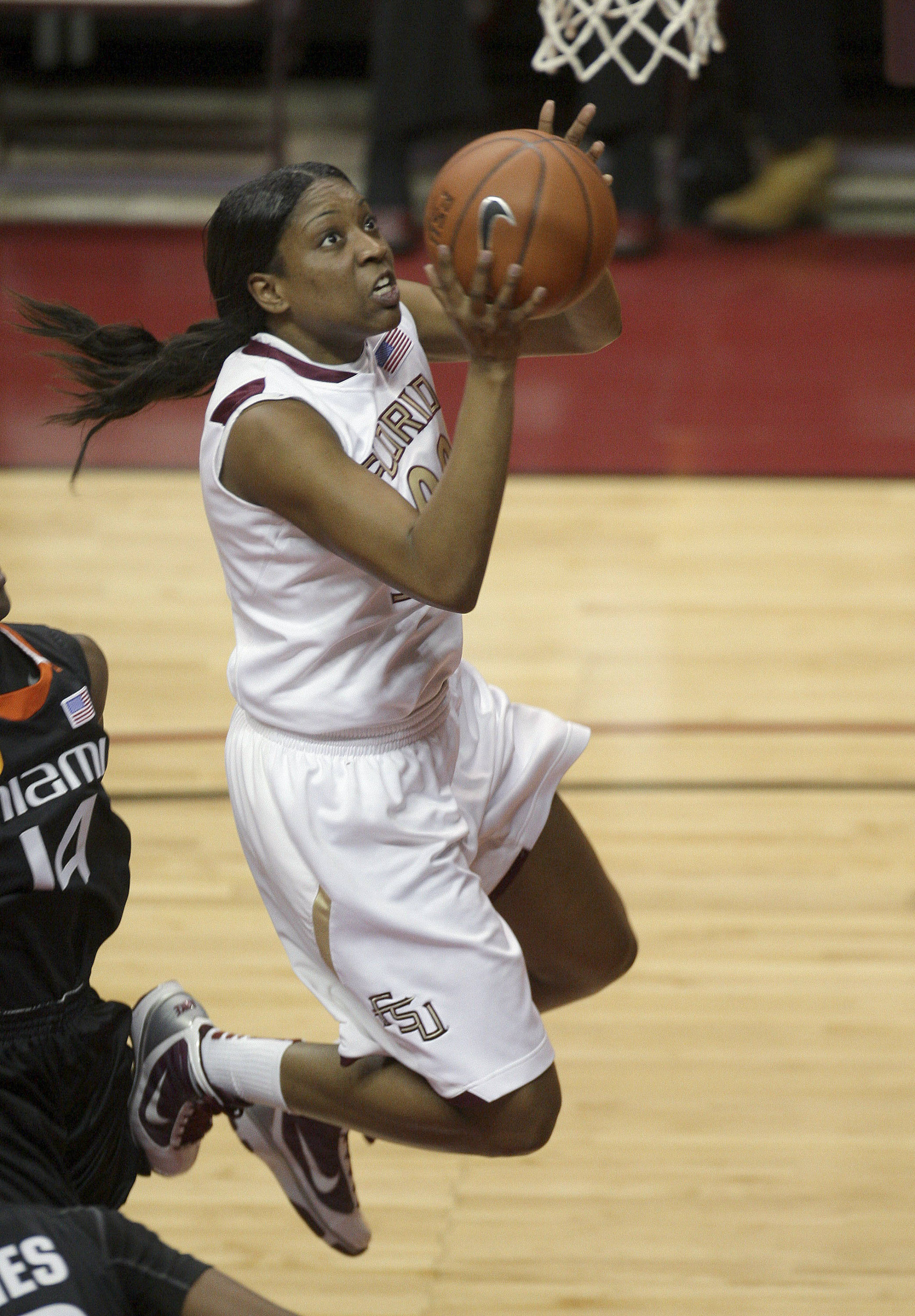 Florida State's Chasity Clayton drives to the basket during the first half of an NCAA college basketball game against Miami, Thursday, Feb. 25, 2010, in Tallahassee, Fla. (AP Photo/Phil Coale)