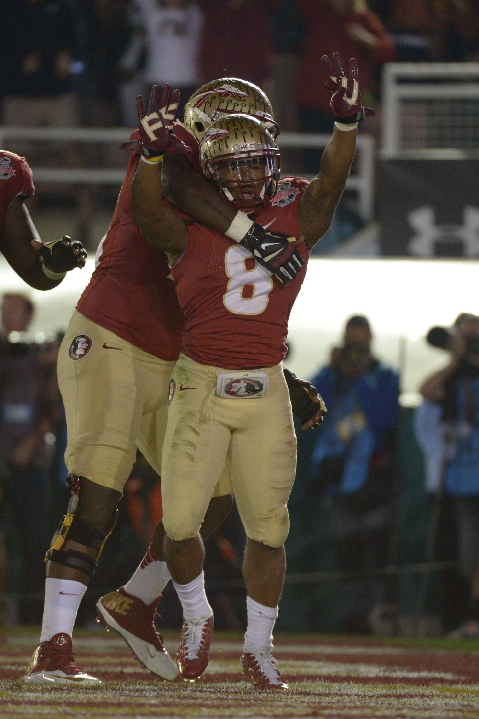Jan 6, 2014; Pasadena, CA, USA; Florida State Seminoles running back Devonta Freeman (8) celebrates after scoring a touchdown against the Auburn Tigers during the first half of the 2014 BCS National Championship game at the Rose Bowl.  Mandatory Credit: Kirby Lee-USA TODAY Sports
