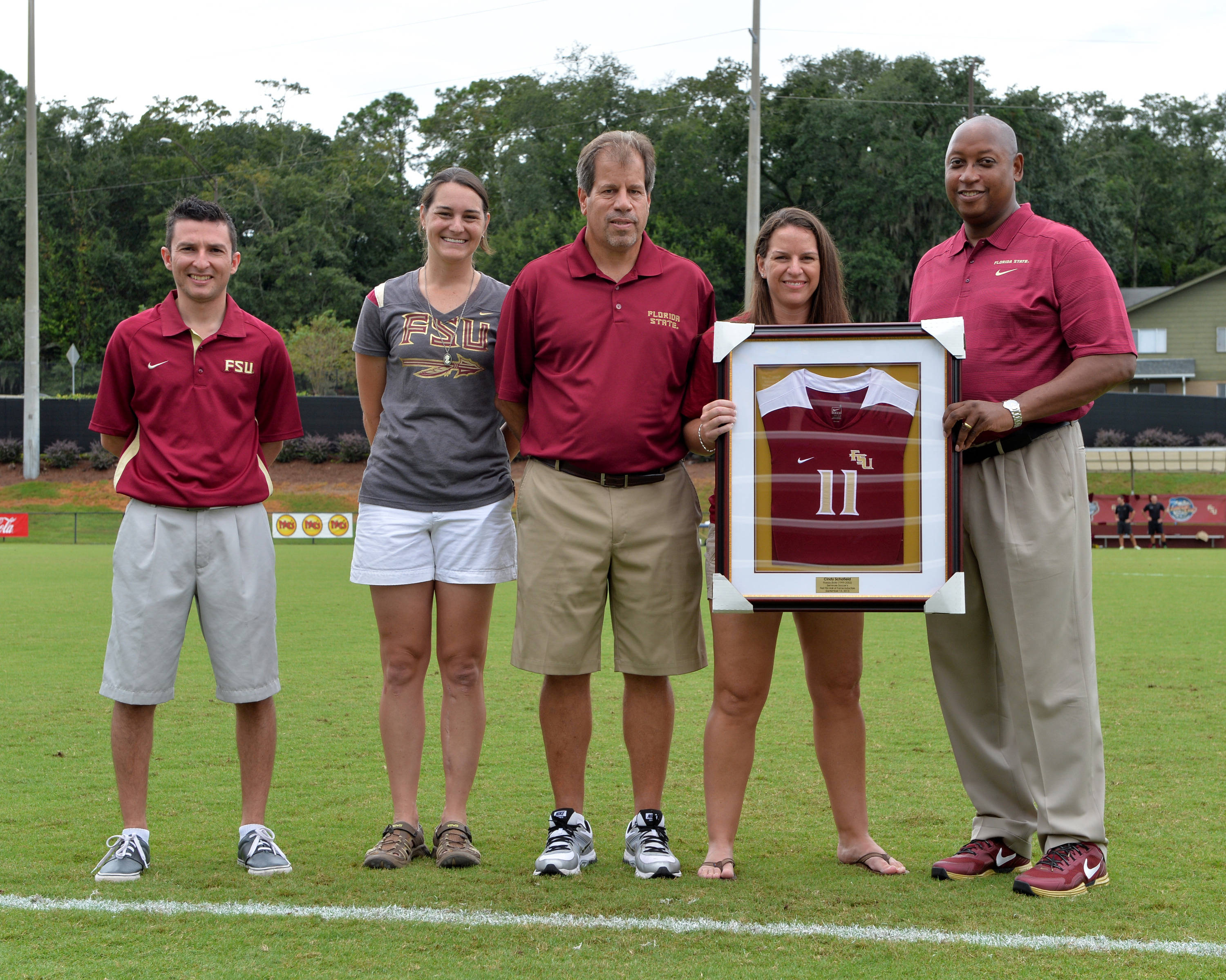 Florida State honored former Seminole great and 2013 FSU Hall of Fame inductee Cindy Schofield on Sunday. Pictured (L to R): Randy Villalba (Cindy's fiancé), Ali Mims, FSU head coach Mark Krikorian, Cindy Schofield and Florida State AD Stan Wilcox.