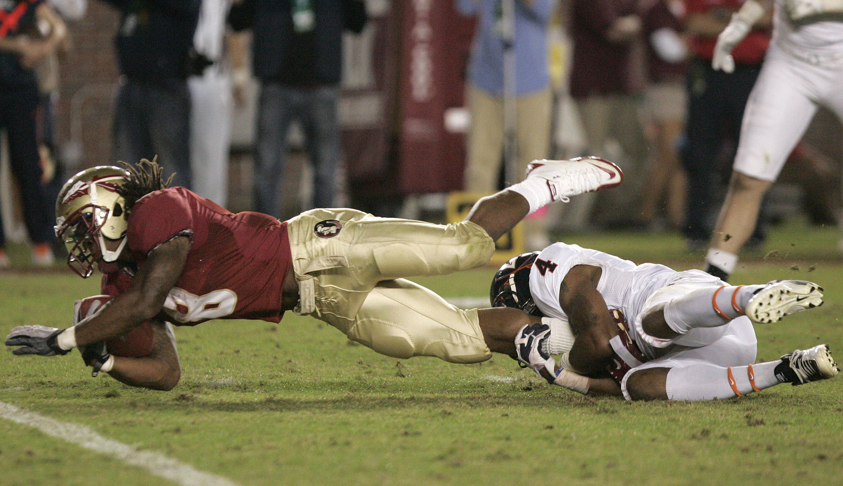 Florida State's Devonta Freeman dives forward as he is tackled by Virginia's Rodney McLeod.(AP Photo/Steve Cannon)