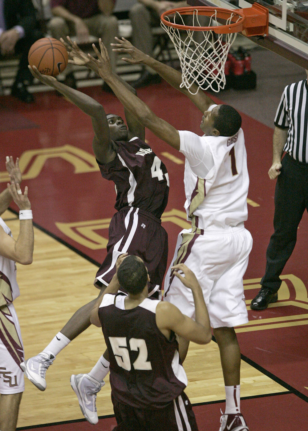 Alabama A&M's Bo Amusa tries to get a shot off against Florida State's Xavier Gibson in the first half of an NCAA college basketball game Thursday, Dec. 31, 2009, in Tallahassee, Fla. (AP Photo/Steve Cannon)