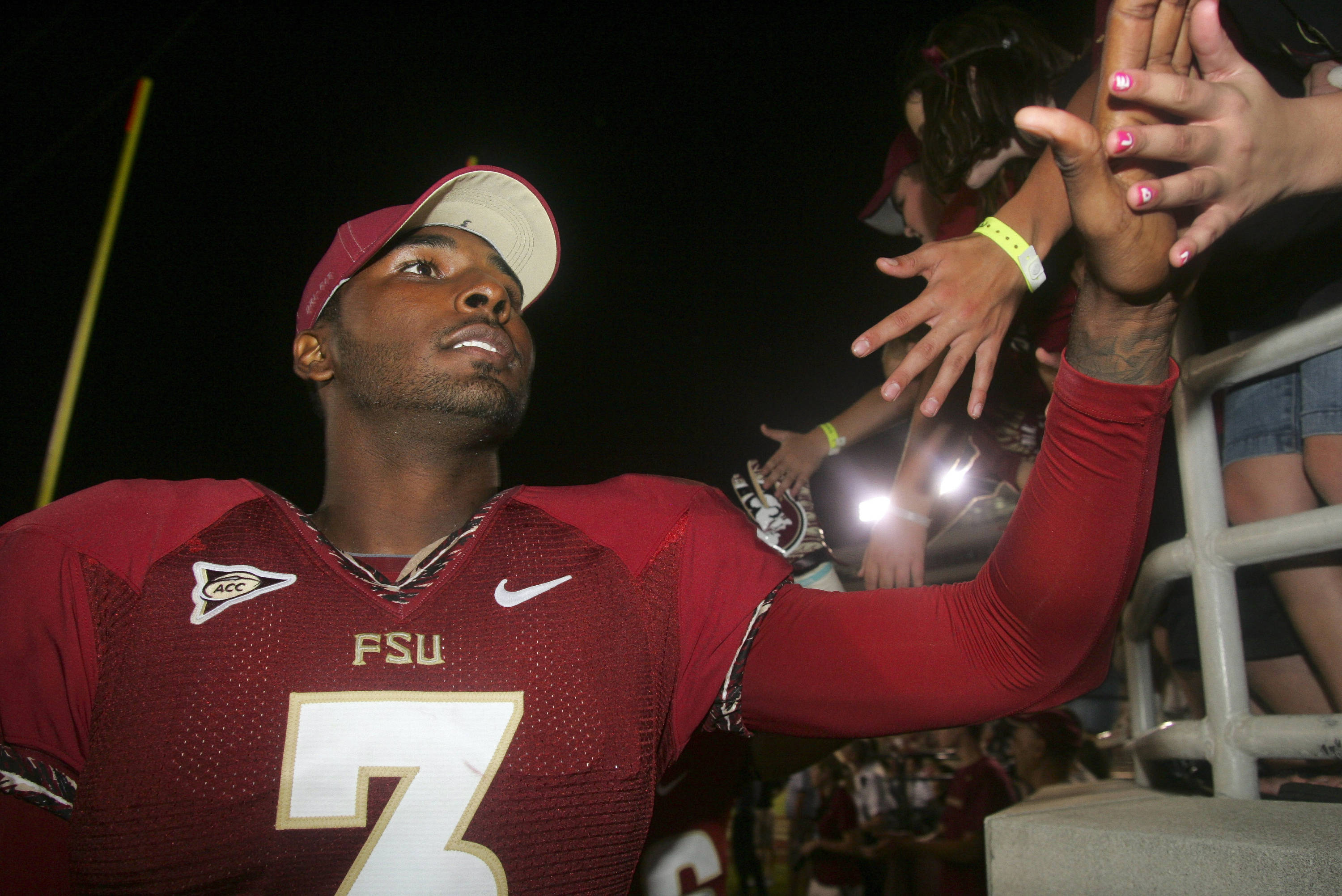 Florida State quarterback E.J. Manuel (3) celebrates with a fan after their 69-3 win over Murray State. (AP Photo/Phil Sears)