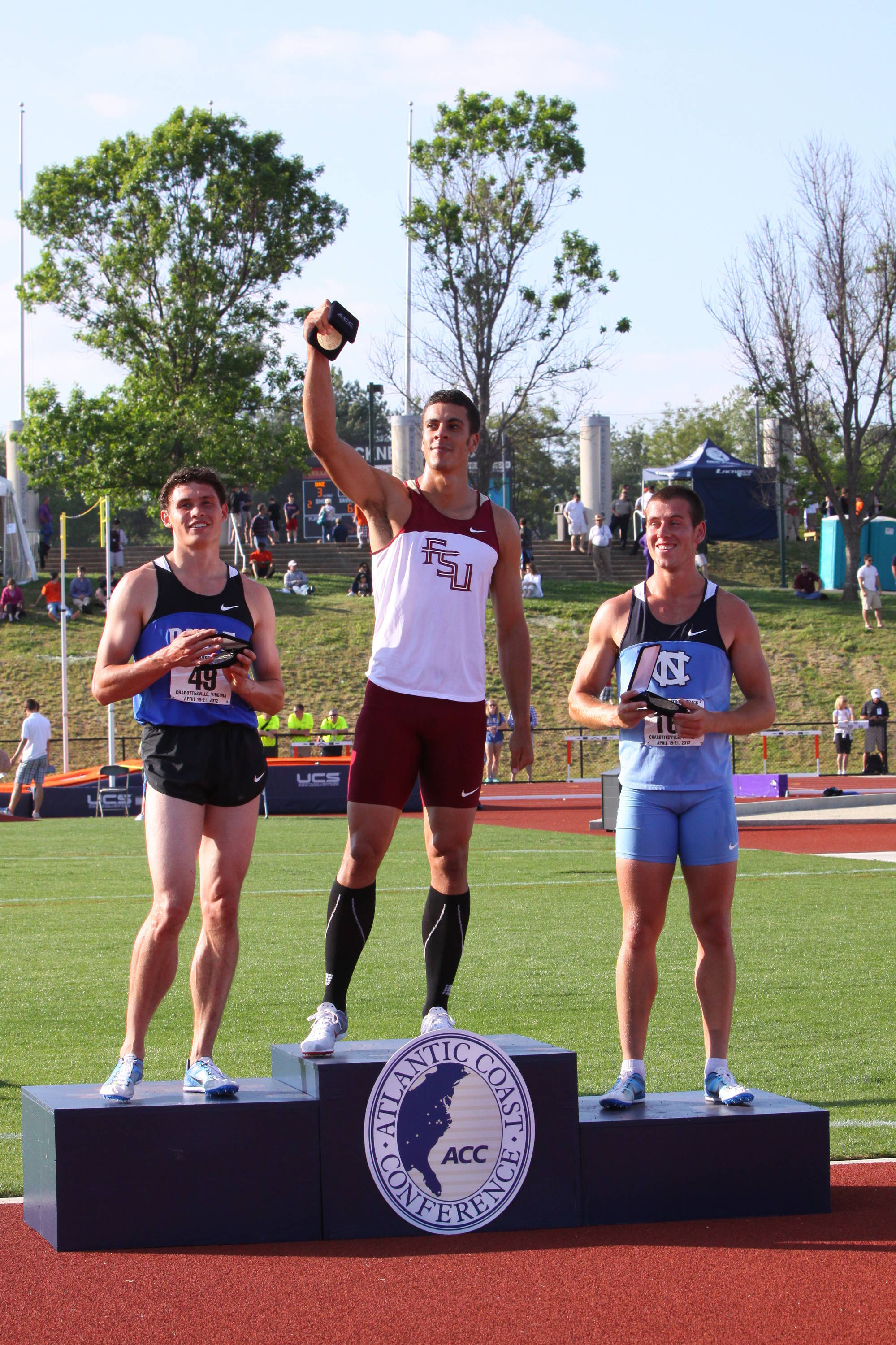 Then proudly raised his medal high, acknowledging the appreciative crowd at Virginia's Lannigan Field.