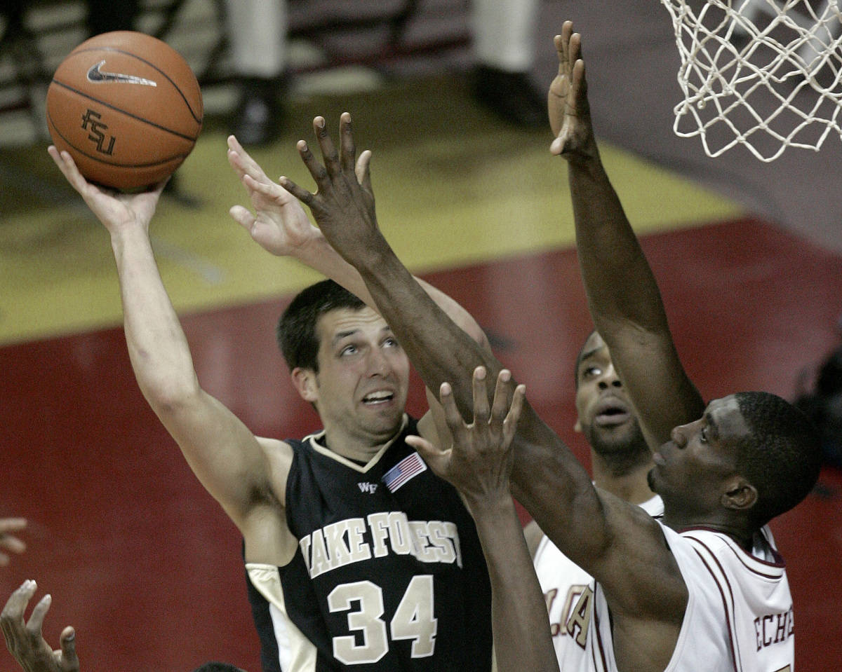 Wake Forest's Michael Drum (34) attempts a first-half shot as Florida State's Isaiah Swann, center, and Uche Echefu defend during a basketball game Saturday, Jan. 27, 2007, in Tallahassee, Fla. (AP Photo/Phil Coale)