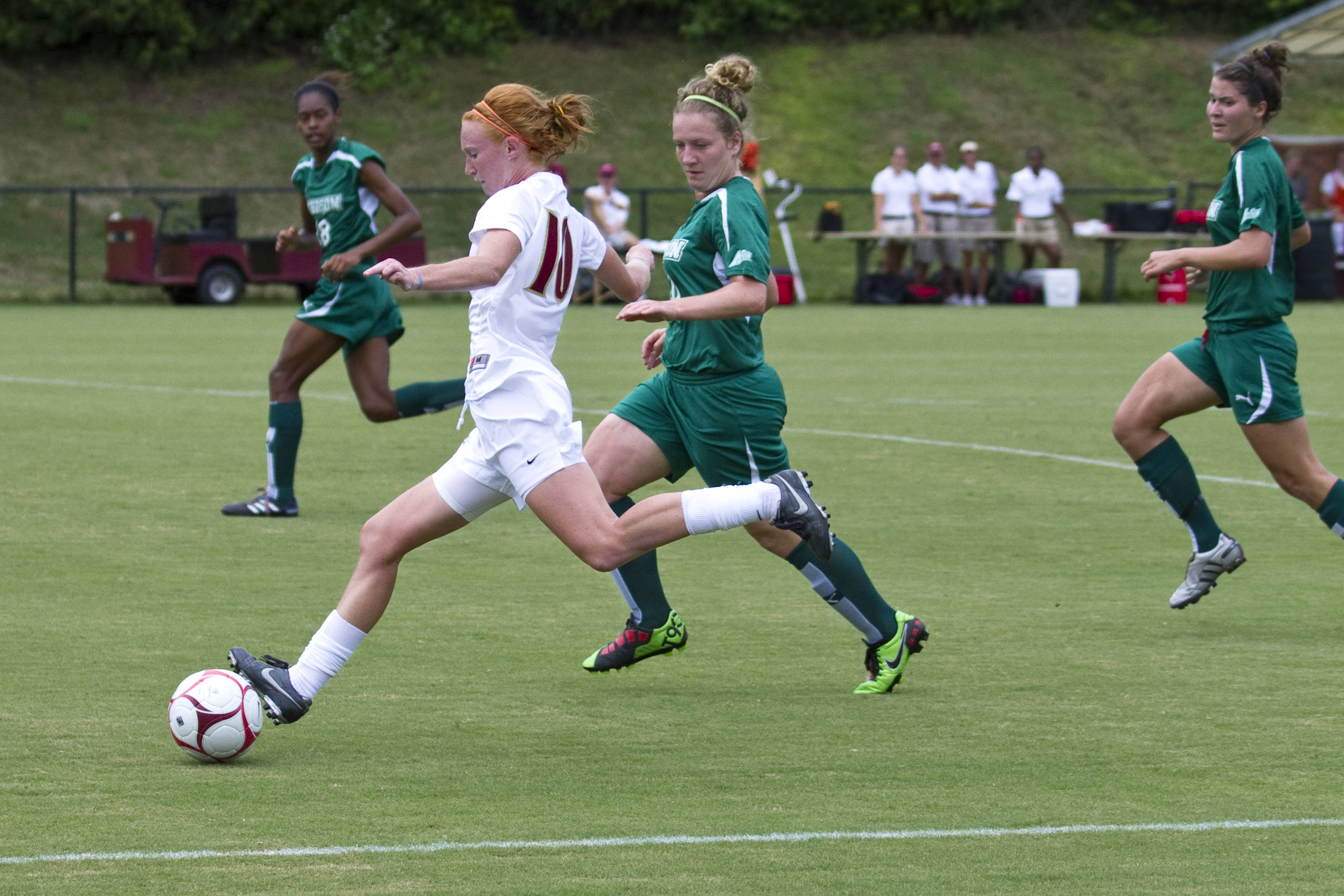 Tori Huster (10) carries the ball down the sideline against Stetson, setting up the play which led to the Seminoles' first goal.