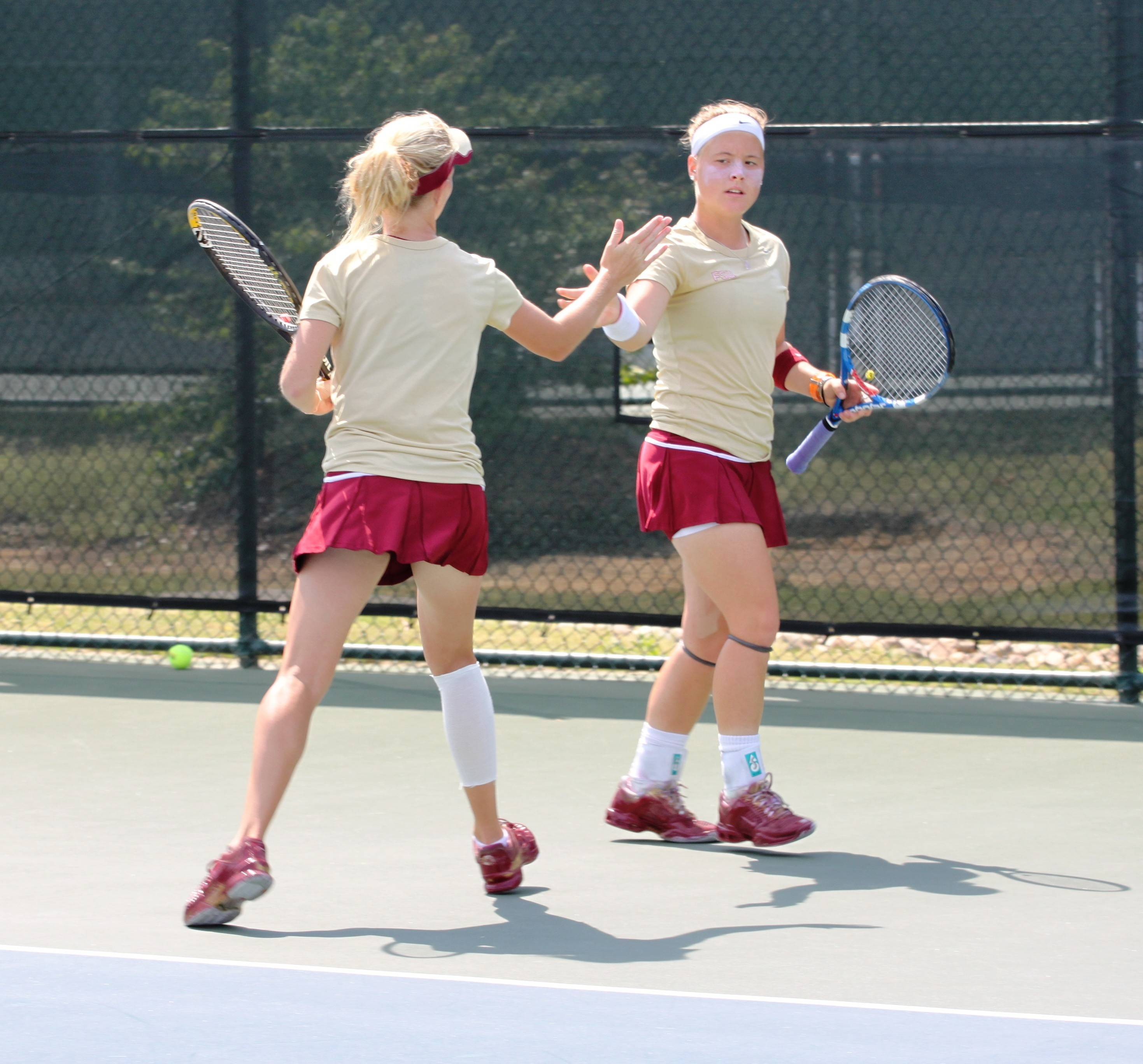 Katie Rybakova and Amy Sargeant in doubles.