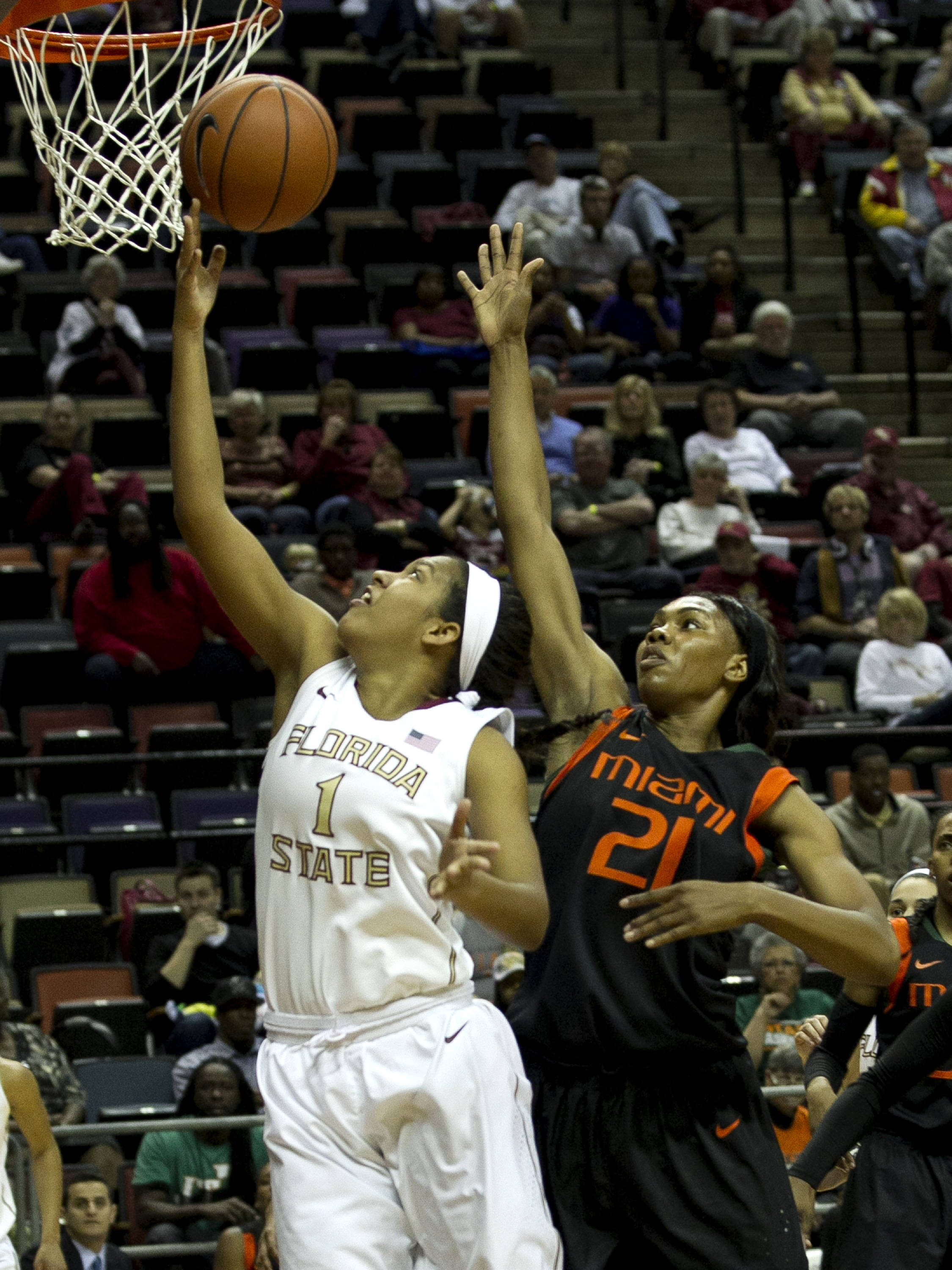 Morgan Jones (1) scores a close two, FSU vs Miami, 2-16-14, (Photo's by Steve Musco)
