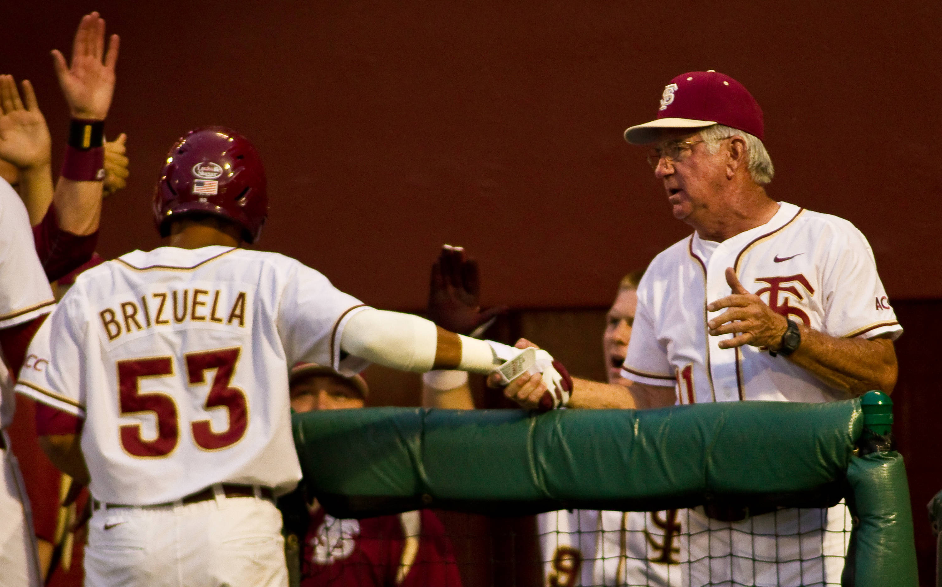 Jose Brizuela shakes hands with Mike Martin.