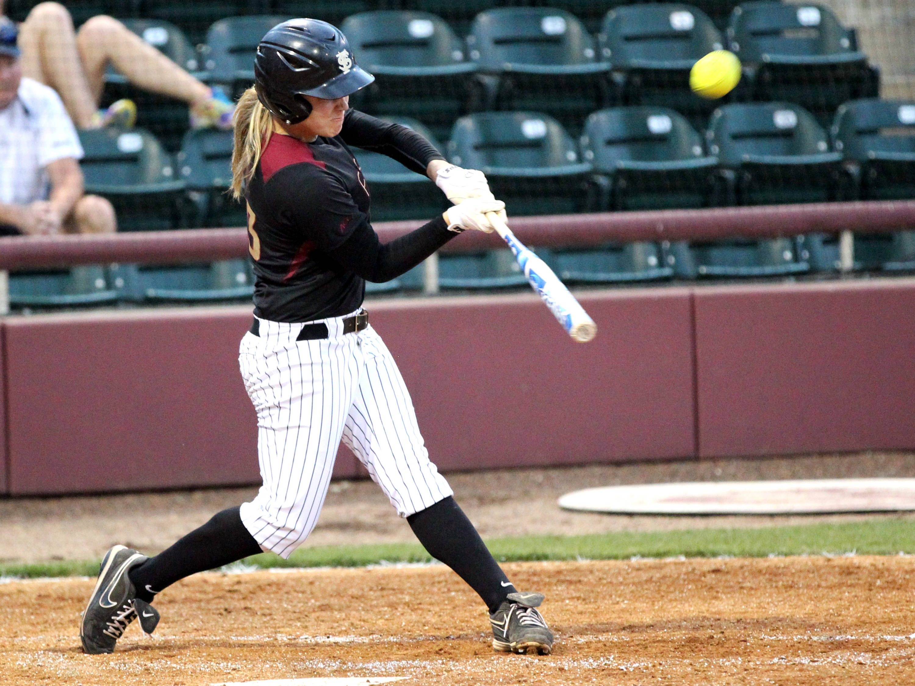 Kelly Hensley launching her triple, FSU vs Virginia, 04/13/13 . (Photo by Steve Musco)