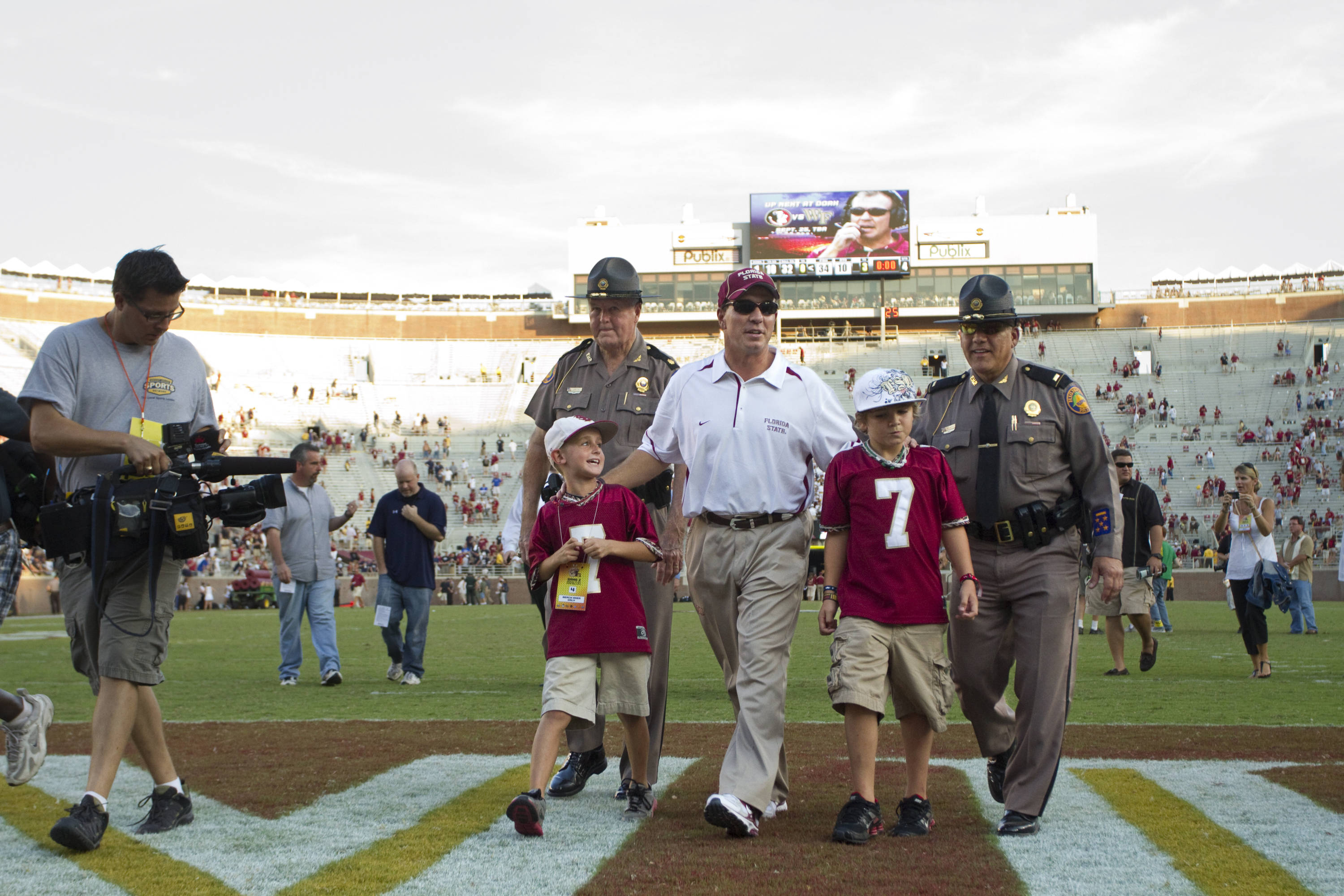 Jimbo Fisher walks off the field after the win against BYU.