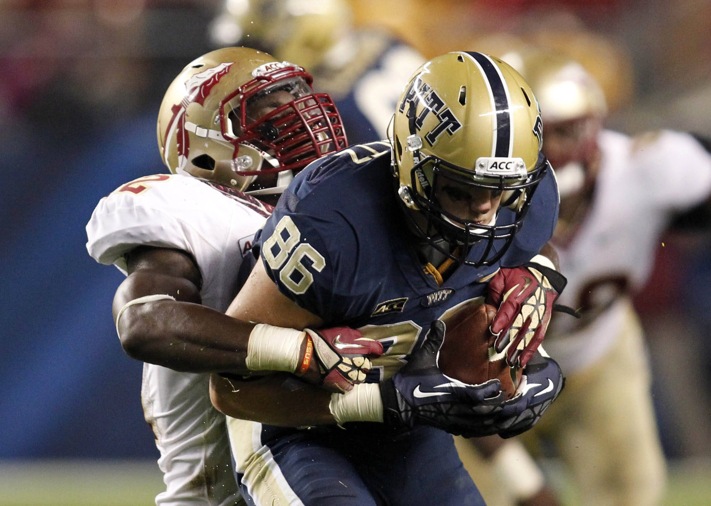 Pittsburgh Panthers tight end J.P. Holtz (86) runs after a pass reception as Florida State Seminoles linebacker Matthew Thomas (12) defends during the second quarter at Heinz Field. Mandatory Credit: Charles LeClaire-USA TODAY Sports