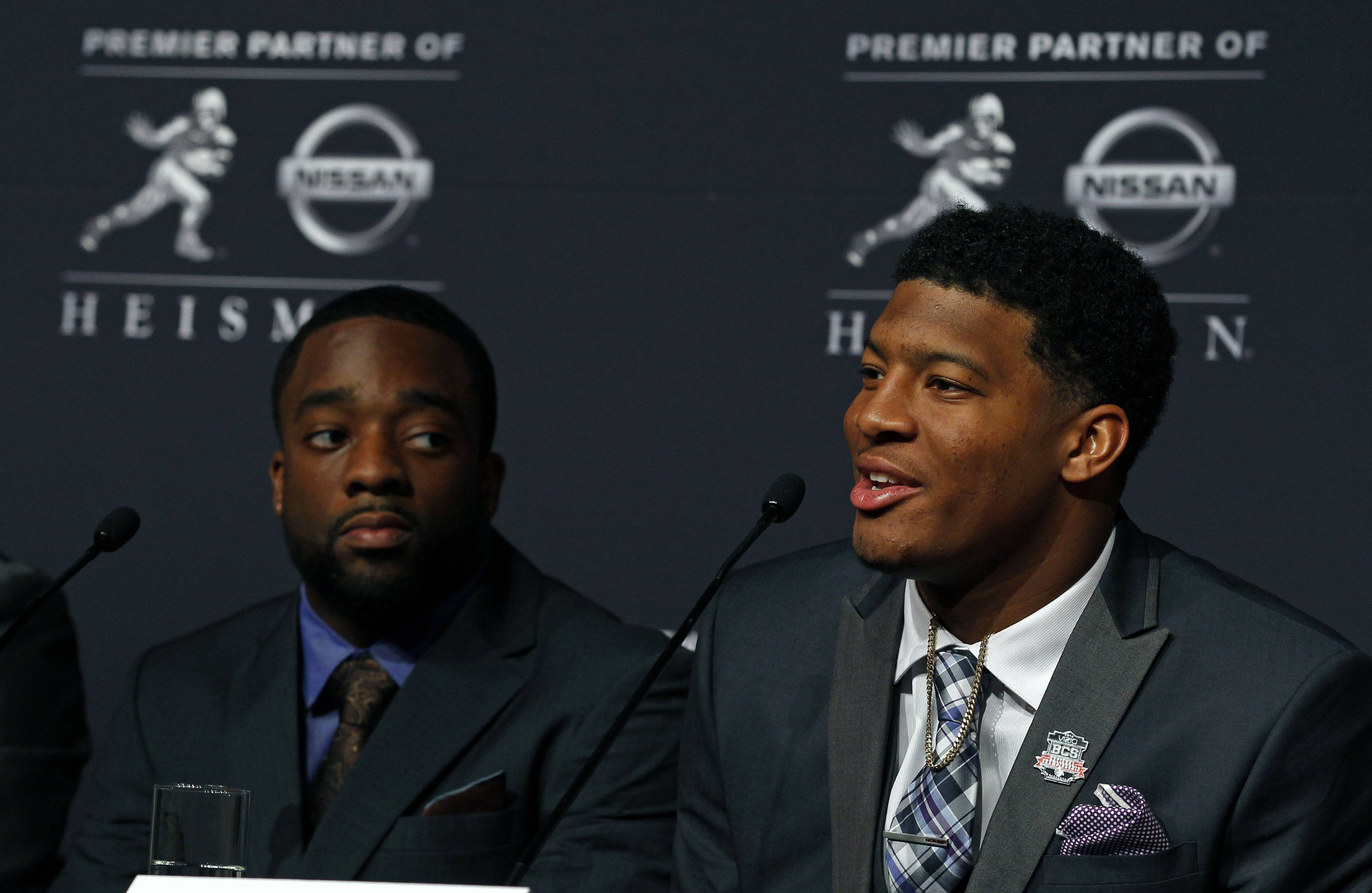 Dec 14, 2013; New York, NY, USA; Seminoles quarterback Jameis Winston and Boston College Eagles running back Andre Williams (left) during a press conference before the announcement of the 2013 Heisman Trophy winner. Adam Hunger-USA TODAY Sports