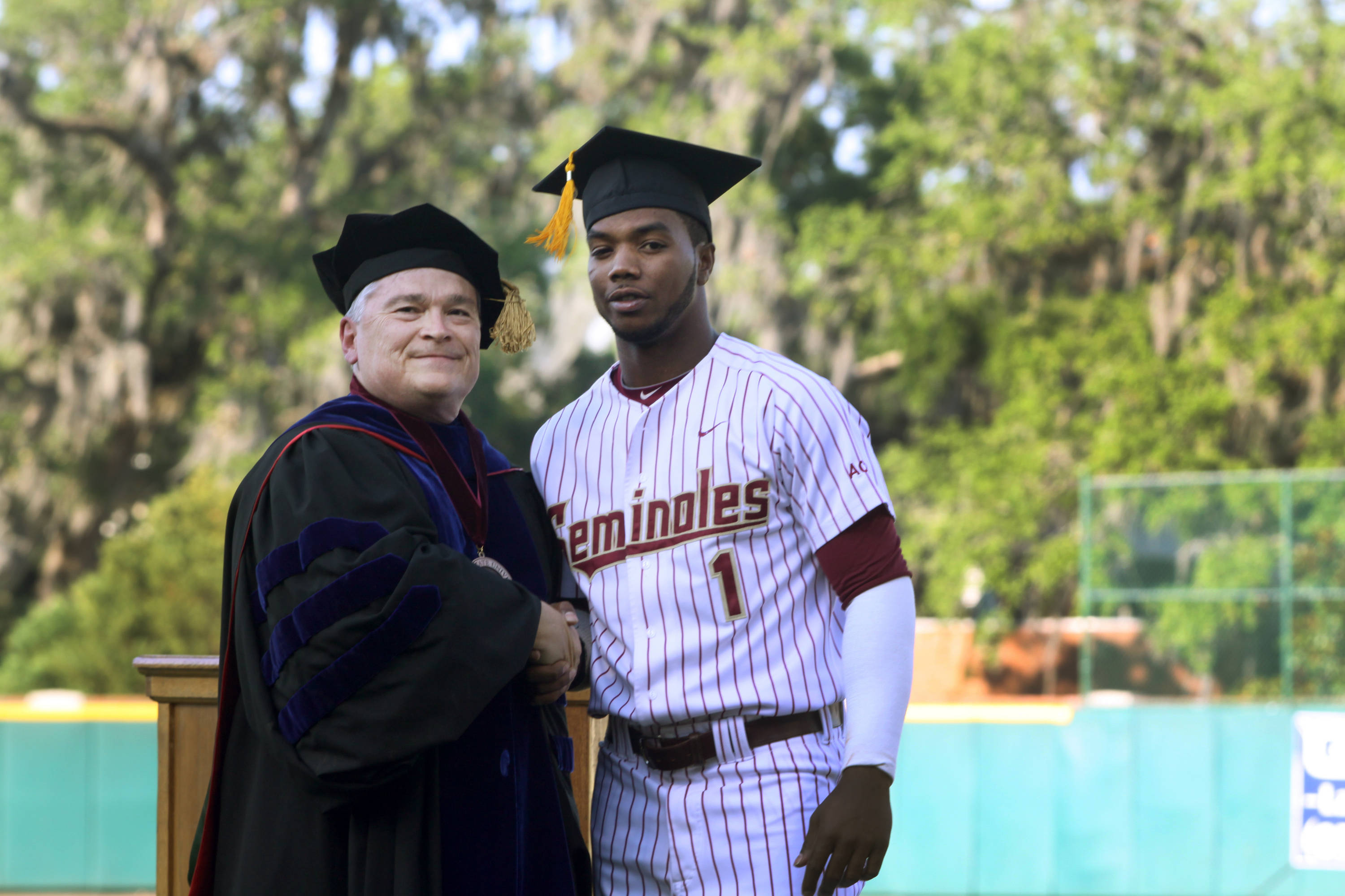 2011 Spring Graduation Ceremony held at Dick Howser Stadium to honor the graduating baseball seniors. Taiwan Easterling (1) with President Barron