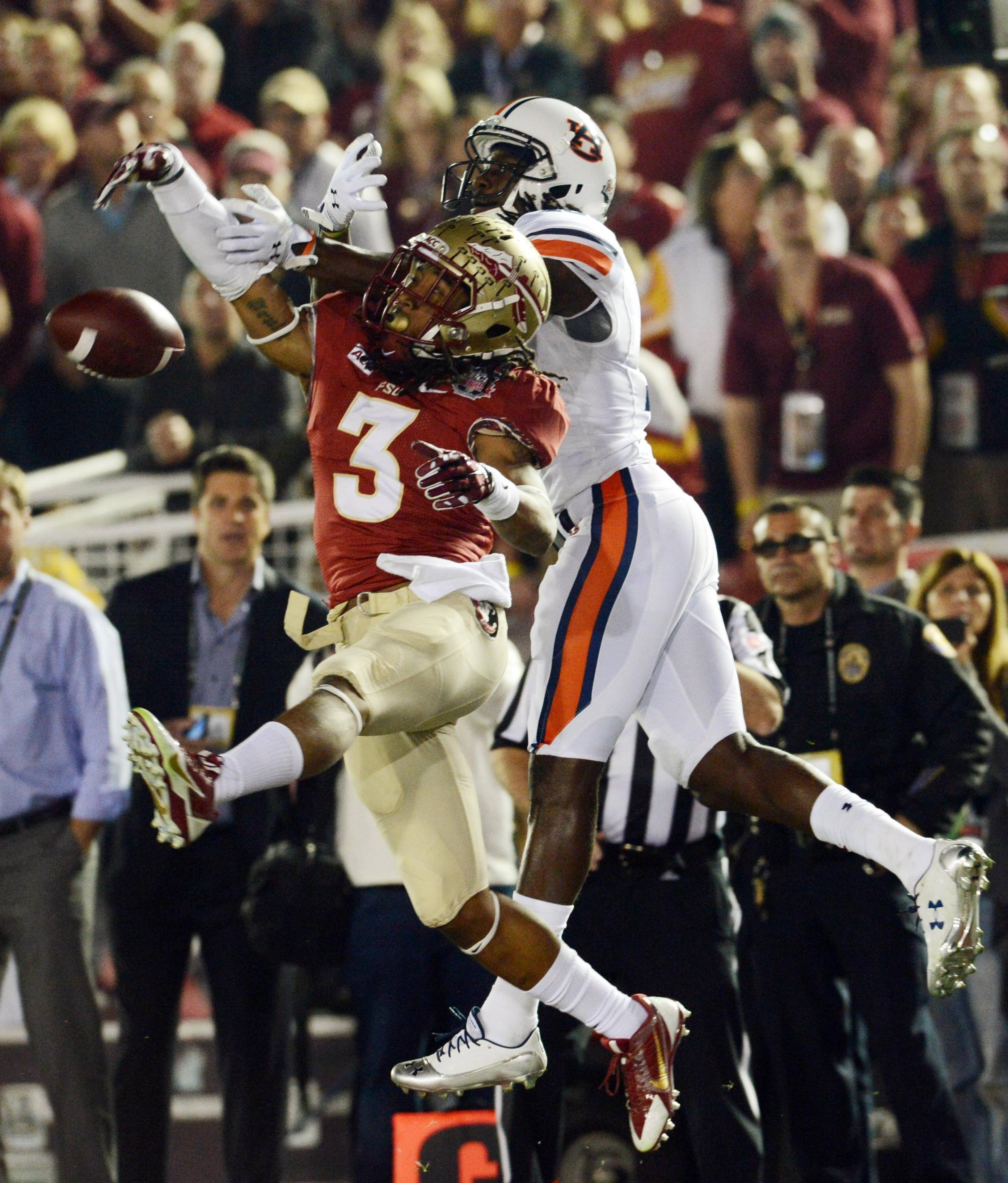 Jan 6, 2014; Pasadena, CA, USA; Florida State Seminoles defensive back Ronald Darby (3) breaks up a pass to Auburn Tigers wide receiver Sammie Coates (18) during the first half of the 2014 BCS National Championship game at the Rose Bowl.  Mandatory Credit: Jayne Kamin-Oncea-USA TODAY Sports
