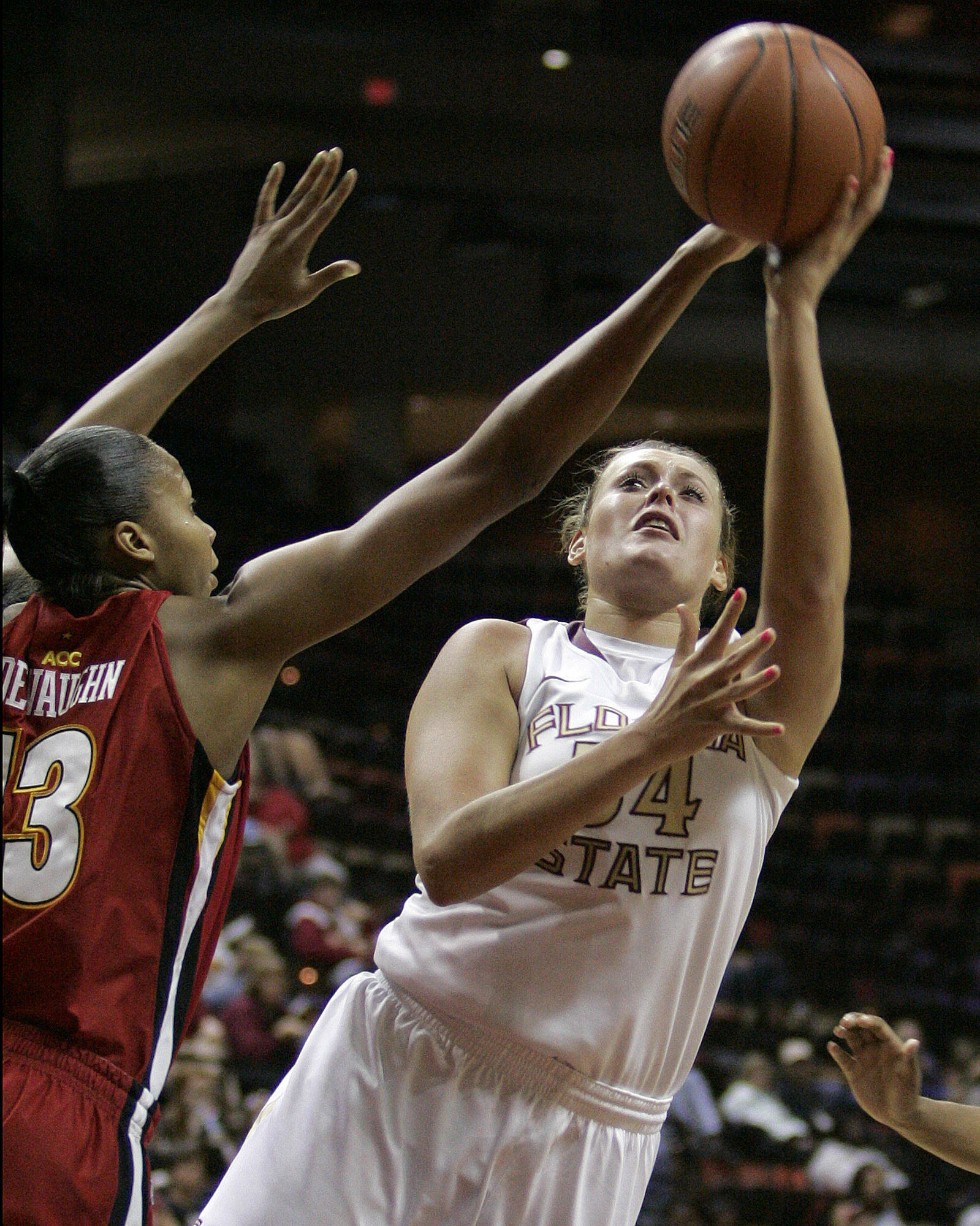 Florida State's Cierra Bravard, right, shoots against Maryland's Alicia DeVaughn in the second half of an NCAA college basketball game on Monday, Jan. 2, 2012, in Tallahassee, Fla. Maryland won 91-70. (AP Photo/Steve Cannon)