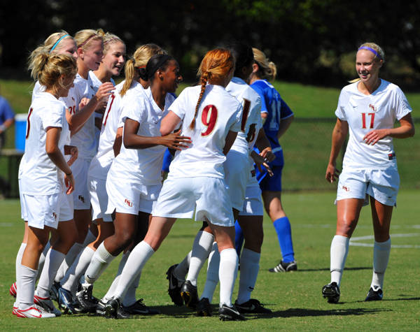 The Seminoles celebrate after scoring in the first half.
