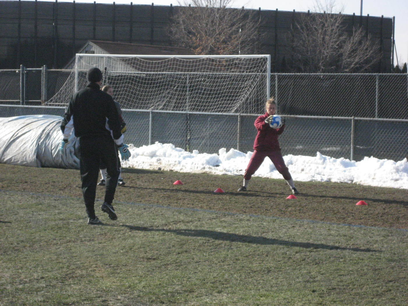 Training day on Thursday in South Bend. Assistant Coach Paul Rogers works with goalkeeper Kate Milstead and Kimmy Diaz.