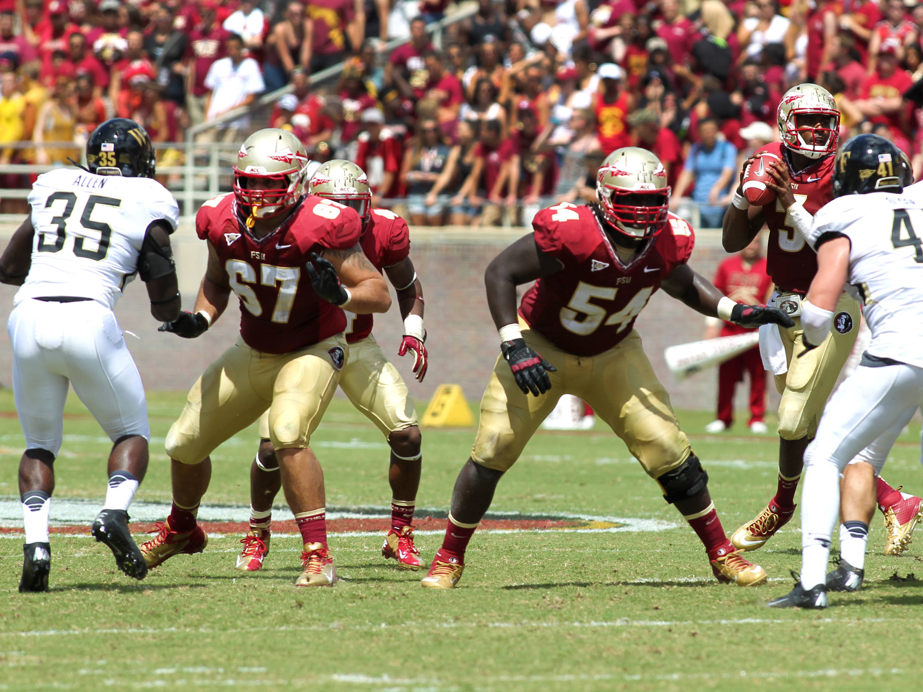 Daniel Glauser (67) and Tre' Jackson (54) protecting quarterback EJ Manuel (3), FSU vs Wake Forest, 9/15/12 (Photo by Steve Musco)