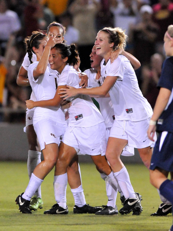 The Seminoles celebrate after Lim's brilliant goal with less than 10 minutes left to play in the game.