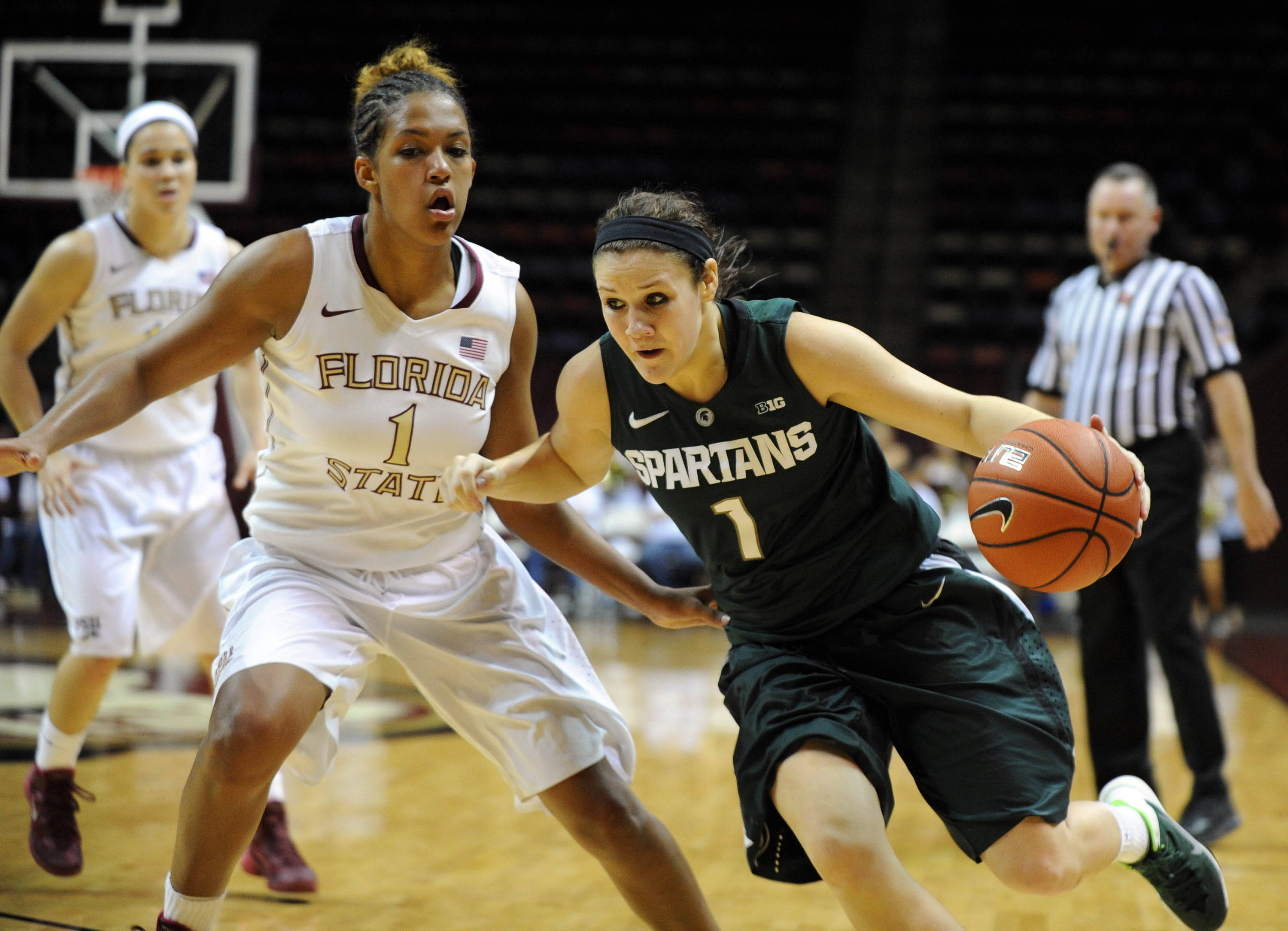 Dec 4, 2013; Tallahassee, FL, USA; Michigan State guard Tori Jankoska (1) moves past Florida State Seminoles guard Morgan Jones (1) during the game at the Donald L. Tucker Center (Tallahassee). Mandatory Credit: Melina Vastola-USA TODAY Sports