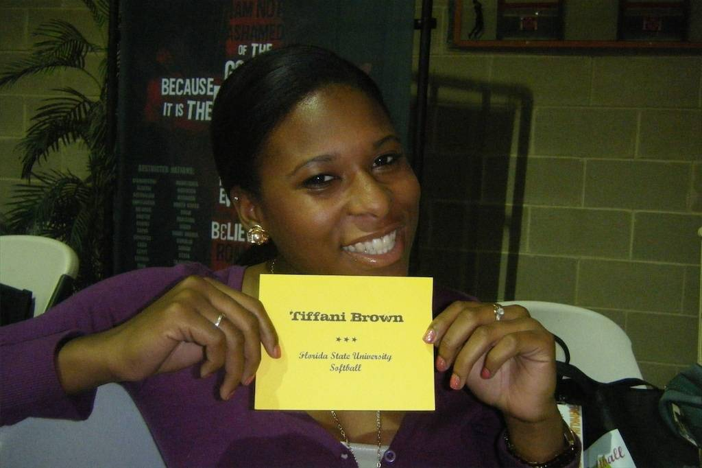 Tiffani Brown smiles proudly with her place card! The Tallahassee resident was honored to be a part of the youth event