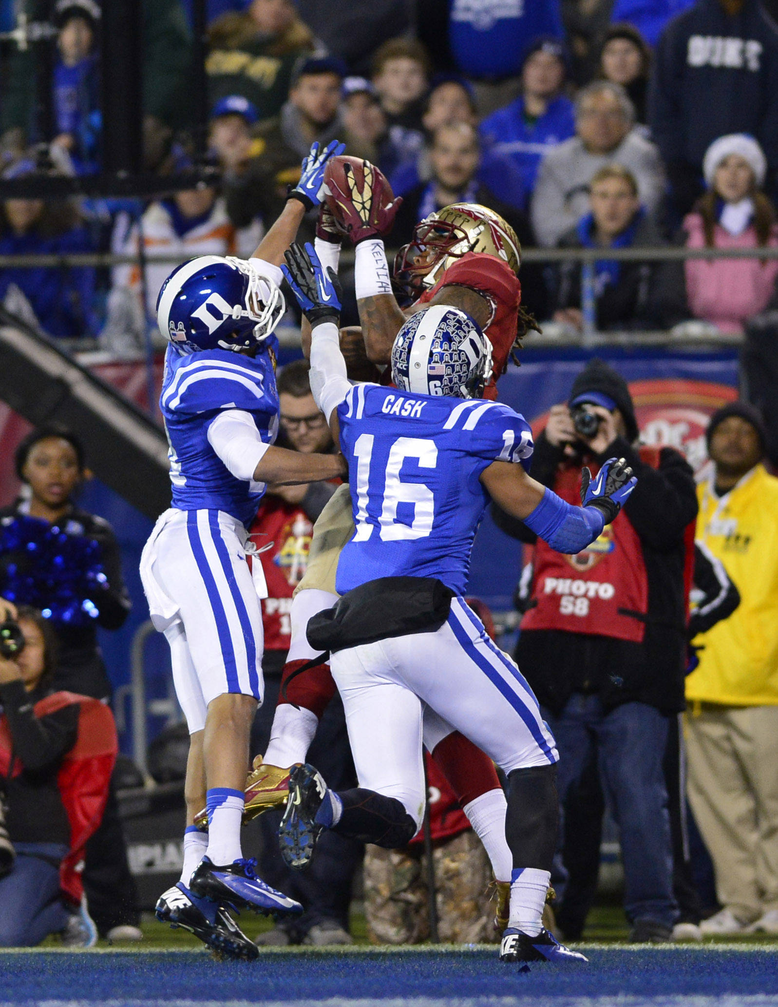 Dec 7, 2013; Charlotte, NC, USA; Florida State Seminoles wide receiver Kelvin Benjamin (1) catches a touchdown pass as Duke Blue Devils cornerback Bryon Fields (14) and safety Jeremy Cash (16) defend in the second quarter at Bank of America Stadium. Mandatory Credit: Bob Donnan-USA TODAY Sports