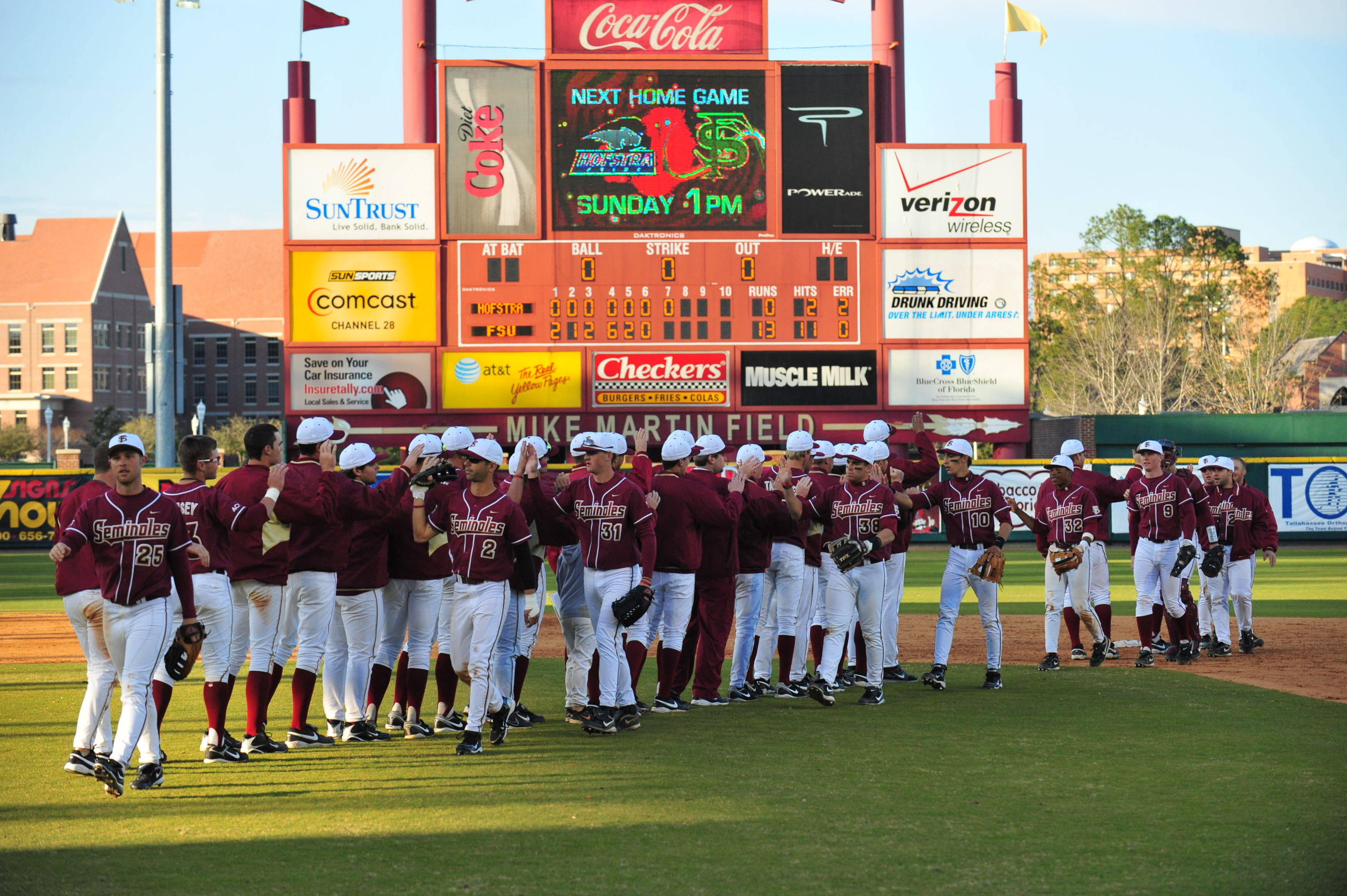 The Seminoles celebrate after taking both games of a doubleheader against the Pride.